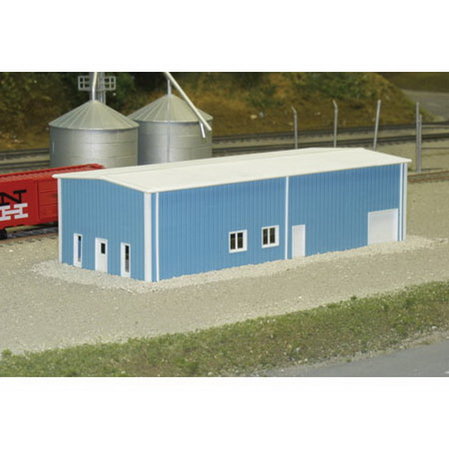 Pikestuff 541-8003 N KIT Pre-Fab Warehouse This is Rix 5418003 N Scale Prefab Warehouse Kit. Building shown 20 scale feet tall. This kit is designed with cut lines on the back side of the walls so that you can choose the height of the building. Walls are 24 scale feet high with cut lines to produce a 20,16,12, and 10 foot tall building. Side walls and End walls have door and window openings provided. Solid walls have cut lines for door and window openings (optional). Kit includes doors, windows and down spouts. Dimensions: 30 X 80 Scale Feet.Condition: Factory New (C-9All original; unused; factory rubs and evidence of handling, shipping and factory test run.Standards for all toy train related accessory items apply to the visual appearance of the item and do not consider the operating functionality of the equipment.Condition and Grading Standards are subjective, at best, and are intended to act as a guide. )Operational Status: FunctionalThis item is brand new from the factory.Original Box: Yes (P-9May have store stamps and price tags. Has inner liners.)Manufacturer: PikestuffModel Number: 541-8003MSRP: $20.95Scale/Era: N ScaleModel Type: BuildingsAvailability: Ships in 2 Business Days!The Trainz SKU for this item is P11555765. Track: 11555765 - No Location Assigned - 001 - TrainzAuctionGroup00UNK - TDIDUNK