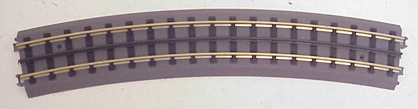 MTH 40-1082 RealTrax O82 Curved Track This is a single section of Here is an MTH 40-1082 RealTrax O-82 Curved Track Section. 16 Sections are required to make A 82 inch diameter circle. Realtrax does not require connecting pins or rail joiners, the sections are snap-together, they have molded realistic roadbed, authentic looking railroad ties, and hollow nickel-silver and steel rails. Realtrax is simply the easiest O Gauge track system ever manufactured. Featuring solid metal rails strong enough to stand on and a built-in roadbed for a realistic appearance ensures that a RealTrax layout will last for years while sporting a realistic appearance not found in other O Gauge track systems. RealTrax incorporates built-in track bed joiners and long-lasting sprung- metal electrical connectors that make assembling RealTrax literally a snap. Because the roadbed is solid, RealTrax is perfect for temporary carpet based layouts. The built-in roadbed prevents any dirt from staining your carpet and it comes apart so easily that your temporary layout can be disassembled in minutes. While the RealTrax system employs hollow nickel-silver rails that won't rust or oxidize in an outdoor environment, the plastic roadbed and rail ties are constructed of ABS plastic that can be compromised outdoors. Essentially, ABS plastic is not designed to withstand extreme temperature swings and can distort (in high heat) or crack in extreme cold. In addition, the plastic will tend to fade in color since it has not been treated with UV resistant paint. As a result, we do not recommend that RealTrax be used outdoors.Condition: Factory New (C-9All original; unused; factory rubs and evidence of handling, shipping and factory test run.Standards for all toy train related accessory items apply to the visual appearance of the item and do not consider the operating functionality of the equipment.Condition and Grading Standards are subjective, at best, and are intended to act as a guide. )Operational Status: Fun