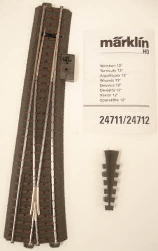 Marklin 24711 Left Wide Radius C Turnout Switch Here is a Marklin 24711 Left Wide Radius C Turnout Switch. Marklin C track is world famous for its stability, realism, safety, durability, and quick setup. Just click and you're finished, with no breakable plastic parts on the ends of the tracks! Marklin track uses the technique of using a third rail concealed in the roadbed with only small studs protruding through the ties of the track to provide simplified wiring. The two outer rails are connected electrically. Please note that Marklin track is not compatible with Atlas, Bachmann, or other 2-rail HO scale track.Condition: Factory New (C-9All original; unused; factory rubs and evidence of handling, shipping and factory test run.Standards for all toy train related accessory items apply to the visual appearance of the item and do not consider the operating functionality of the equipment.Condition and Grading Standards are subjective, at best, and are intended to act as a guide. )Operational Status: FunctionalThis item is brand new from the factory.Original Box: Yes (P-9May have store stamps and price tags. Has inner liners.)Manufacturer: MarklinModel Number: 24711Years Manufactured: 2000 - 2006MSRP: $39.99Scale/Era: HO ModernModel Type: Track/Switches/Etc.Availability: Ships in 2 Business Days!The Trainz SKU for this item is P11403679. Track: 11403679 - S66 (Shelf)  - 001 - TrainzAuctionGroup00UNK - TDIDUNK