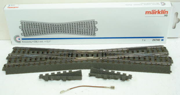 Marklin 24740 Wide Angle C Track Crossing Marklin C track is world famous for its stability, realism, safety, durability, and quick setup. Just click and you're finished, with no breakable plastic parts on the ends of the tracks! Marklin track uses the technique of using a third rail concealed in the roadbed with only small studs protruding through the ties of the track to provide simplified wiring. The two outer rails are connected electrically. Please note that Marklin track is not compatible with Atlas, Bachmann, or other 2-rail HO scale track.Condition: Factory New (C-9All original; unused; factory rubs and evidence of handling, shipping and factory test run.Standards for all toy train related accessory items apply to the visual appearance of the item and do not consider the operating functionality of the equipment.Condition and Grading Standards are subjective, at best, and are intended to act as a guide. )Operational Status: FunctionalThis item is brand new from the factory.Original Box: Yes (P-9May have store stamps and price tags. Has inner liners.)Manufacturer: MarklinModel Number: 24740MSRP: $32.99Scale/Era: HO ModernModel Type: Track/Switches/Etc.Availability: Ships in 2 Business Days!The Trainz SKU for this item is P11403681. Track: 11403681 - S66 (Shelf)  - 001 - TrainzAuctionGroup00UNK - TDIDUNK