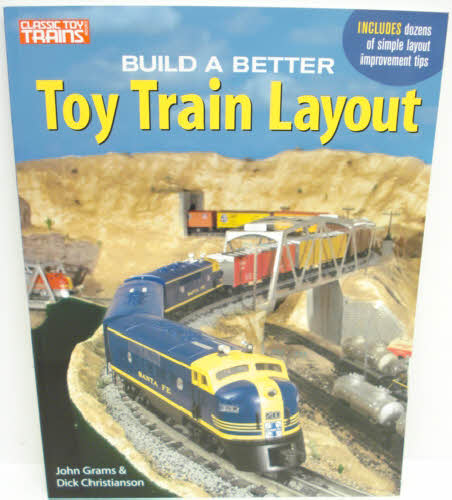 """Kalmbach 10-8803 Build A Better Toy Train Layout When you think of a """"better"""" toy train layout, what comes tp mind? Everyone's got an idea of what makes a layout better - how do you decide what's right for you? This book contains easy-to-follow advice which includes inventive ways to mix rolling stock and accessories of different scales, innovative solutions for cleaning and maintaining track, and creative ideas for unique scenery and details.Condition: Factory NewOperational Status: FunctionalThis item is brand new from the factory.Original Box: YesManufacturer: KalmbachModel Number: 10-8803Years Manufactured: 2004 - 2004MSRP: $18.95Category 1: Books and MediaCategory 2: O Scale Books & MediaAvailability: Ships within 3 Business Days!The Trainz SKU for this item is P11389885. Track: 11389885 - 1008-B (Suite 2740-200)  - 001 - TrainzAuctionGroup00UNK - TDIDUNK"""