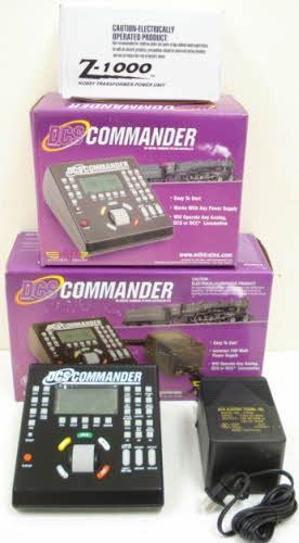 MTH 50-1029 DCS Commander Controller Set This is an MTH 50-1029 DCS Command Controller Set. MTH's Digital Command System (DCS) unlocks the full sound and operating potential of Proto-Sound 2.0 or later equipped locomotives. Insert a DCS Commander in the wires from your existing DCC system to the track and you can switch back and forth between DCC and DCS with the push of a button. Because many M.T.H. Proto-Sound 2.0 locomotives can operate on both AC or DC current, the DCS Commander may be the affordable DCS command control option you've been looking for. The DCS commander outputs up to 18 volts of DC power and includes a built-in 5amp resettable breaker making it a perfect solution for small M.T.H. O Gauge layouts exclusively running Proto-Sound 2.0 locomotives. For HO operators, the DCS Commander Controller Set is a perfect power solution for almost any size HO layout. HO operators whose layouts are already outfitted with a DC power supply can choose the individual DCS Commander and plug their existing power supply right into the Commander's power inputs. The DCS Commander offers intuitive control of multiple Proto-Sound engines; for each locomotive, more than 32 functions are available at the touch of a single, clearly-labeled button. In addition to the features available with DCC and analog DC, the DCS Commander unlocks a long list of Proto-Sound operating possibilities. Model 50-1029 adds a 100 watt power supply making the DCS Commander essentially a three-in-one device as a stand-alone power pack for analog operation, a DCS controller for operating M.T.H. HO locomotives with Proto-Sound 3.0 and as a pass-thru for DCC signals for engines equipped with DCC receivers. Features include Speed adjustment in one-scale-mile-per hour steps, Independent feature control: tune your engines' sound, lights, smoke and acceleration/deceleration settings, Smoke on/off, Doppler sounds: simulate the classic sound effect of a train approaching and then whizzing pas