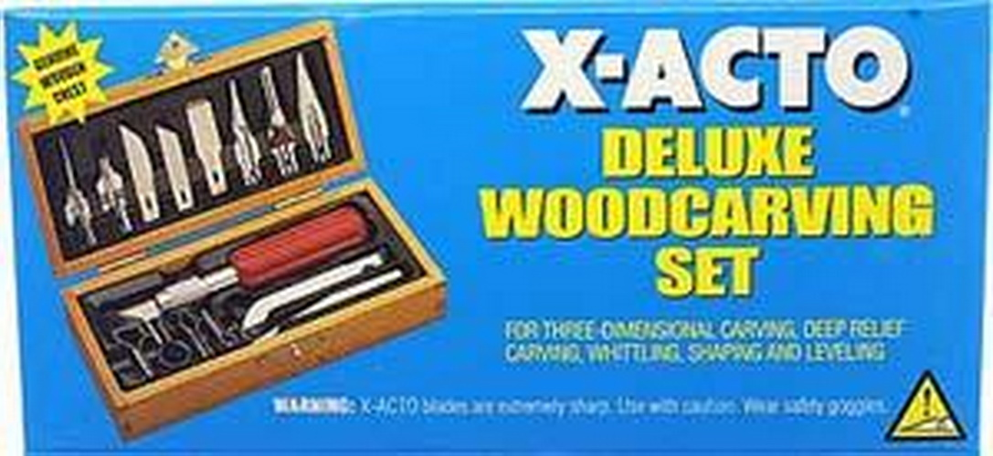 X-Acto 5175 Deluxe Wood Carving Knife Set This is a X-Acto 5175 Deluxe Wood Carving Knife Set. The X-ACTO Deluxe Wood Carving Set is the complete package for virtually any wood working project imaginable. With X-ACTO quality knives, blades and other wood working tools, you know you are getting quality that will last for years to come. Featuring an attractive wooden chest for organized storage and display, this wood carving set makes a perfect gift idea. Our Deluxe Wood Carving Set includes the following woodworking equipment: #5 knife with #24 deburring blade, #18 heavy chiseling blade, #19 angled chiseling blade, #22 curved carving blade, #26 whittling blade, #27 blade, Five gouges, Four routers.Condition: Factory NewOperational Status: FunctionalThis item is brand new from the factory.Original Box: YesManufacturer: X-ActoModel Number: 5175MSRP: $44.50Category 1: Maintenance & SuppliesCategory 2: ToolsAvailability: Ships in 3 to 5 Business Days.The Trainz SKU for this item is P11543889. Track: 11543889 - FS - 001 - TrainzAuctionGroup00UNK - TDIDUNK