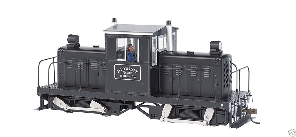 Bachmann 29201 On30 Midwest Quarry Whitcomb 50-Ton Center-Cab w/DCC #1 This is a Bachmann 29201 On30 Midwest Quarry Whitcomb 50-Ton Center-Cab w/DCC #12. Bachmann is excited to introduce the 50-Ton Center-Cab Whitcomb On30 diesel locomotive. These hard workers handled duties everywhere from industrial rail yards to sugar plantations. It is being offered in a DCC-equipped model ready for the addition of 16-bit Tsunami® plug-and-play prototypical sound. (Separate-sale Item No. 44955, Whitcomb Plug-and-Play Sound Module, required for sound-on-board performance.) Features include: DCC-equipped for speed, direction, and lighting, sound-ready with factory-installed speakers, dual-mode NMRA-compliant decoder, die-cast construction, soft white LED directional headlights, precision motor, eight-wheel drive, dual balanced brass flywheels, metal handrails, photo-etched brass grille, metal cut levers, detailed cab with engineer, optional die-cast bell and horn included, E-Z Mate® Mark II couplers, performs best on 15 radius curves or greater. Painted in color black and silver.Condition: Factory New (C-9All original; unused; factory rubs and evidence of handling, shipping and factory test run.Standards for all toy train related accessory items apply to the visual appearance of the item and do not consider the operating functionality of the equipment.Condition and Grading Standards are subjective, at best, and are intended to act as a guide. )Operational Status: FunctionalThis item is brand new from the factory.Original Box: Yes (P-9May have store stamps and price tags. Has inner liners.)Manufacturer: BachmannModel Number: 29201Road Name: MidwestMSRP: $449.00Scale/Era: On30 ScaleModel Type: Locomotives, DieselAvailability: Ships in 1 Business Day!The Trainz SKU for this item is P12002498. Track: 12002498 - S01 (Shelf)  - 001 - TrainzAuctionGroup00UNK - TDIDUNK