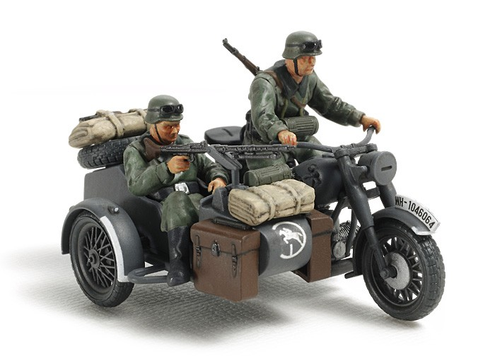 Tamiya 32578 1/48 German Motorcycle w/Sidecar This is the 1/48 Scale German Motorcycle and Sidecar Plastic Model Kit from the Tamiya Military Miniature Series. Suitable for Ages 14 & Older.Product FeaturesHighly detailed plastic pieces molded in tan.Sturdy frame and flat twin engine accurately replicated.Choose from standard and large air cleaner parts.Driver and passenger figures included.Waterslide decals.Illustrated instructions.Condition: Factory NewOperational Status: FunctionalThis item is brand new from the factory.Original Box: YesManufacturer: TamiyaModel Number: 32578MSRP: $17.00Category 1: Other ToysCategory 2: Model KitsAvailability: Ships in 3 to 5 Business Days.The Trainz SKU for this item is P12000382. Track: 12000382 - FS - 001 - TrainzAuctionGroup00UNK - TDIDUNK