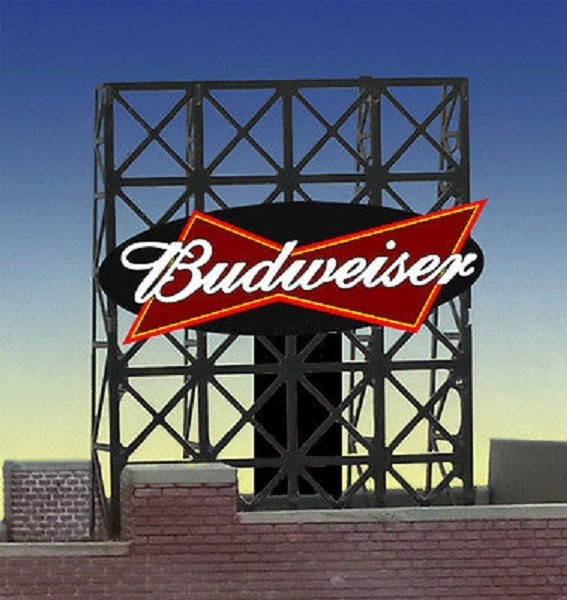 Miller Engineering 338815 N/Z Budweiser Animated Rooftop Billboard Sma This is a Miller Engineering 338815 N/Z Scales Budweiser Animated Rooftop Billboard Small Lattice Support Size: 1 x 1-3/8 2.5 x 3.4cm .Great addition to your layout or a diorama. Photo-etched frame, with back supports, measures 1.35 inches high x 1 inch wide. Kit includes: Electroluminescence sign lamp Photo-etched frame and supports Power supply (requires 3 AAA batteries - not included) Complete instructions Runs on 3 AAA batteries (not included), or an AC wall adapter or AC/DC power converter (sold separately in my eBay store). Note: CA glue, aka Super Glue, is the recommended adhesive for mounting the supports and sign board (not included).Condition: Factory New (C-9All original; unused; factory rubs and evidence of handling, shipping and factory test run.Standards for all toy train related accessory items apply to the visual appearance of the item and do not consider the operating functionality of the equipment.Condition and Grading Standards are subjective, at best, and are intended to act as a guide. )Operational Status: FunctionalThis item is brand new from the factory.Original Box: Yes (P-9May have store stamps and price tags. Has inner liners.)Manufacturer: Miller EngineeringModel Number: 338815Road Name: BudweiserMSRP: $22.95Scale/Era: N ScaleModel Type: AccessoriesAvailability: Ships in 2 Business Days!The Trainz SKU for this item is P12060074. Track: 12060074 - S01 (Shelf)  - 001 - TrainzAuctionGroup00UNK - TDIDUNK