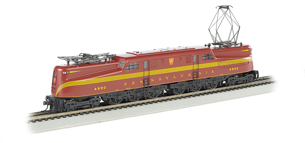 Bachmann 65206 HO Pennsylvania GG1 Electric - Standard DC #4890 This is a Bachmann 65206 HO Scale Pennsylvania GG1 Electric - Standard DC #4890 (5-Stripe, Tuscan). The electric GG-1 was introduced in the 1930s by the Pennsylvania Railroad, which needed a locomotive that could carry more rolling stock at greater speeds. Its dynamic streamlined design captured the public's imagination and made it the star of countless movies and advertisements. This DCC-ready model features include: all new tooling, die-cast frame, 12-wheel drive, twin operating metal pantographs that can be powered by overhead wire if desired, soft white LED directional headlights with dimming function, Factory-installed 8-pin socket ready for DCC decoder installation of your choice, and E-Z Mate® Mark II couplers. Performs best on 22 radius curves or greater.Condition: Factory New (C-9All original; unused; factory rubs and evidence of handling, shipping and factory test run.Standards for all toy train related accessory items apply to the visual appearance of the item and do not consider the operating functionality of the equipment.Condition and Grading Standards are subjective, at best, and are intended to act as a guide. )Operational Status: FunctionalThis item is brand new from the factory.Original Box: Yes (P-9May have store stamps and price tags. Has inner liners.)Manufacturer: BachmannModel Number: 65206Road Name: PennsylvaniaMSRP: $235.00Scale/Era: HO ModernModel Type: Electric LocoAvailability: Ships in 1 Business Day!The Trainz SKU for this item is P12112240. Track: 12112240 - No Location Assigned - 001 - TrainzAuctionGroup00UNK - TDIDUNK