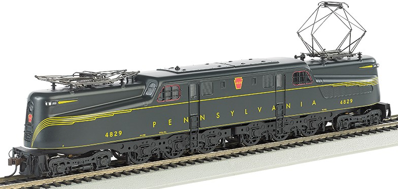 Bachmann 65307 HO Pennsylvania GG1 with Sound & DCC #4829 This is a Bachmann 65307 HO Scale Pennsylvania GG1 with Sound & DCC #4829 The electric GG-1 was introduced in the 1930s by the Pennsylvania Railroad, which needed a locomotive that could carry more rolling stock at greater speeds. Its dynamic streamlined design captured the public's imagination and made it the star of countless movies and advertisements. This DCC sound-equipped model includes our Sound Value SoundTraxx® sound package with prototypical motors with blowers, pantograph extension and retraction, air compressors, short and long horns, and bell–all in 16-bit polyphonic sound. Features include: all new tooling, die-cast frame,12-wheel drive, twin operating metal pantographs that can be powered by overhead wire if desired, soft white LED directional headlights with dimming function, and E-Z Mate® Mark II couplers. Performs best on 22 radius curves or greater.Condition: Factory New (C-9All original; unused; factory rubs and evidence of handling, shipping and factory test run.Standards for all toy train related accessory items apply to the visual appearance of the item and do not consider the operating functionality of the equipment.Condition and Grading Standards are subjective, at best, and are intended to act as a guide. )Operational Status: FunctionalThis item is brand new from the factory.Original Box: Yes (P-9May have store stamps and price tags. Has inner liners.)Manufacturer: BachmannModel Number: 65307Road Name: PennsylvaniaMSRP: $329.00Scale/Era: HO ModernModel Type: Electric LocoAvailability: Ships in 1 Business Day!The Trainz SKU for this item is P12157754. Track: 12157754 - No Location Assigned - 001 - TrainzAuctionGroup00UNK - TDIDUNK
