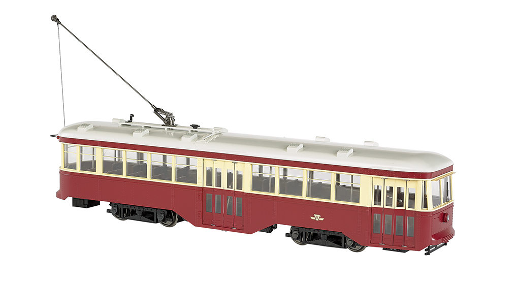 Bachmann 91703 G Toronto Transportation Commission Peter Witt Streetca This is a Bachmann 91703 G Scale Peter Witt Streetcar - Standard DC Toronto Transportation Commission (maroon, cream, white). While serving as Cleveland's Street Railway Commissioner, Peter Witt designed an all-steel, single-operator streetcar that distinguished itself from others of the era by its use of the center door as an exit only. Passengers could pay the waiting motorman as they boarded at the front and exited at the center of the car, an arrangement which reduced stop times, improved schedules, and increased efficiency. Though designed originally for Cleveland, the Peter Witt Streetcar went on to service in cities throughout the world from the 1930s until the early 1960s. Features include: • 1:29 scaling • DCC ready with factory-installed 21-pin and 8-pin sockets for DCC decoder installation of your choice • can be operated on track power or overhead wire (trolley wheel compatible with LGB overhead wire) • sound ready with factory-installed speaker • precision can motor • LED headlight and rear stop light • interior lighting • manually operated front and rear bi-fold doors • painted interior with seats • photo-etched brass safety screen per prototype.Condition: Factory New (C-9All original; unused; factory rubs and evidence of handling, shipping and factory test run.Standards for all toy train related accessory items apply to the visual appearance of the item and do not consider the operating functionality of the equipment.Condition and Grading Standards are subjective, at best, and are intended to act as a guide. )Operational Status: FunctionalThis item is brand new from the factory.Original Box: Yes (P-9May have store stamps and price tags. Has inner liners.)Manufacturer: BachmannModel Number: 91703MSRP: $429.00Scale/Era: G ScaleModel Type: Electric LocoAvailability: Ships in 1 Business Day!The Trainz SKU for this item is P12002884. Track: 12002884 - No Location Assigned - 0