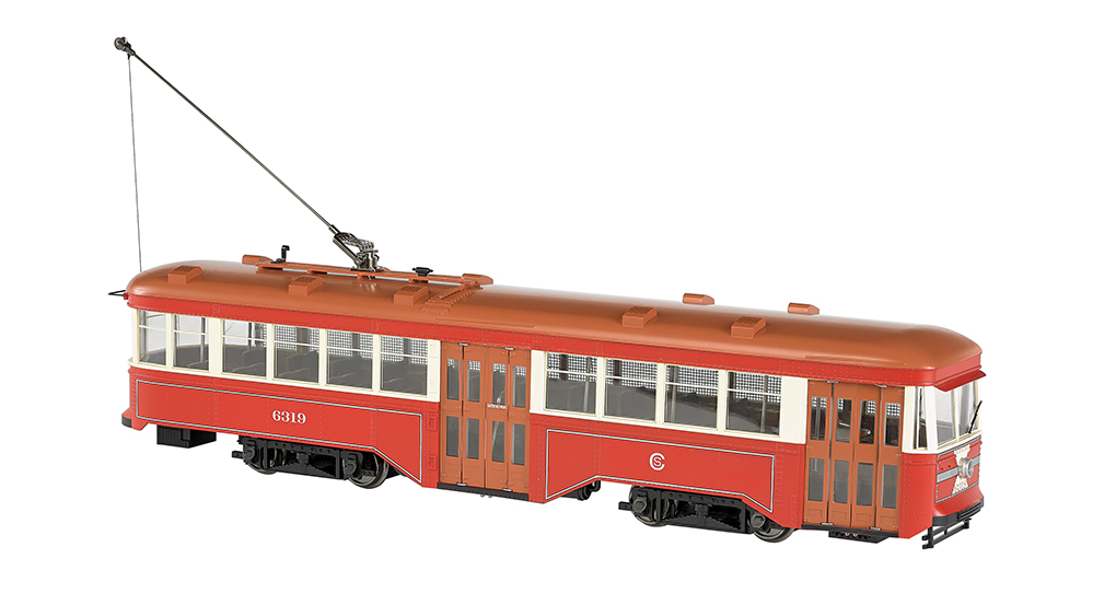 Bachmann 91704 G Chicago Surface Lines Peter Witt Streetcar #6319 This is a Bachmann 91704 G Scale Peter Witt Streetcar - Standard DC Chciago Surface Lines #6319 (red, cream, tan). While serving as Cleveland's Street Railway Commissioner, Peter Witt designed an all-steel, single-operator streetcar that distinguished itself from others of the era by its use of the center door as an exit only. Passengers could pay the waiting motorman as they boarded at the front and exited at the center of the car, an arrangement which reduced stop times, improved schedules, and increased efficiency. Though designed originally for Cleveland, the Peter Witt Streetcar went on to service in cities throughout the world from the 1930s until the early 1960s. Features include: • 1:29 scaling • DCC ready with factory-installed 21-pin and 8-pin sockets for DCC decoder installation of your choice • can be operated on track power or overhead wire (trolley wheel compatible with LGB overhead wire) • sound ready with factory-installed speaker • precision can motor • LED headlight and rear stop light • interior lighting • manually operated front and rear bi-fold doors • painted interior with seats • photo-etched brass safety screen per prototype.Condition: Factory New (C-9All original; unused; factory rubs and evidence of handling, shipping and factory test run.Standards for all toy train related accessory items apply to the visual appearance of the item and do not consider the operating functionality of the equipment.Condition and Grading Standards are subjective, at best, and are intended to act as a guide. )Operational Status: FunctionalThis item is brand new from the factory.Original Box: Yes (P-9May have store stamps and price tags. Has inner liners.)Manufacturer: BachmannModel Number: 91704MSRP: $429.00Scale/Era: G ScaleModel Type: Electric LocoAvailability: Ships in 1 Business Day!The Trainz SKU for this item is P11985402. Track: 11985402 - No Location Assigned - 001 - Trainz