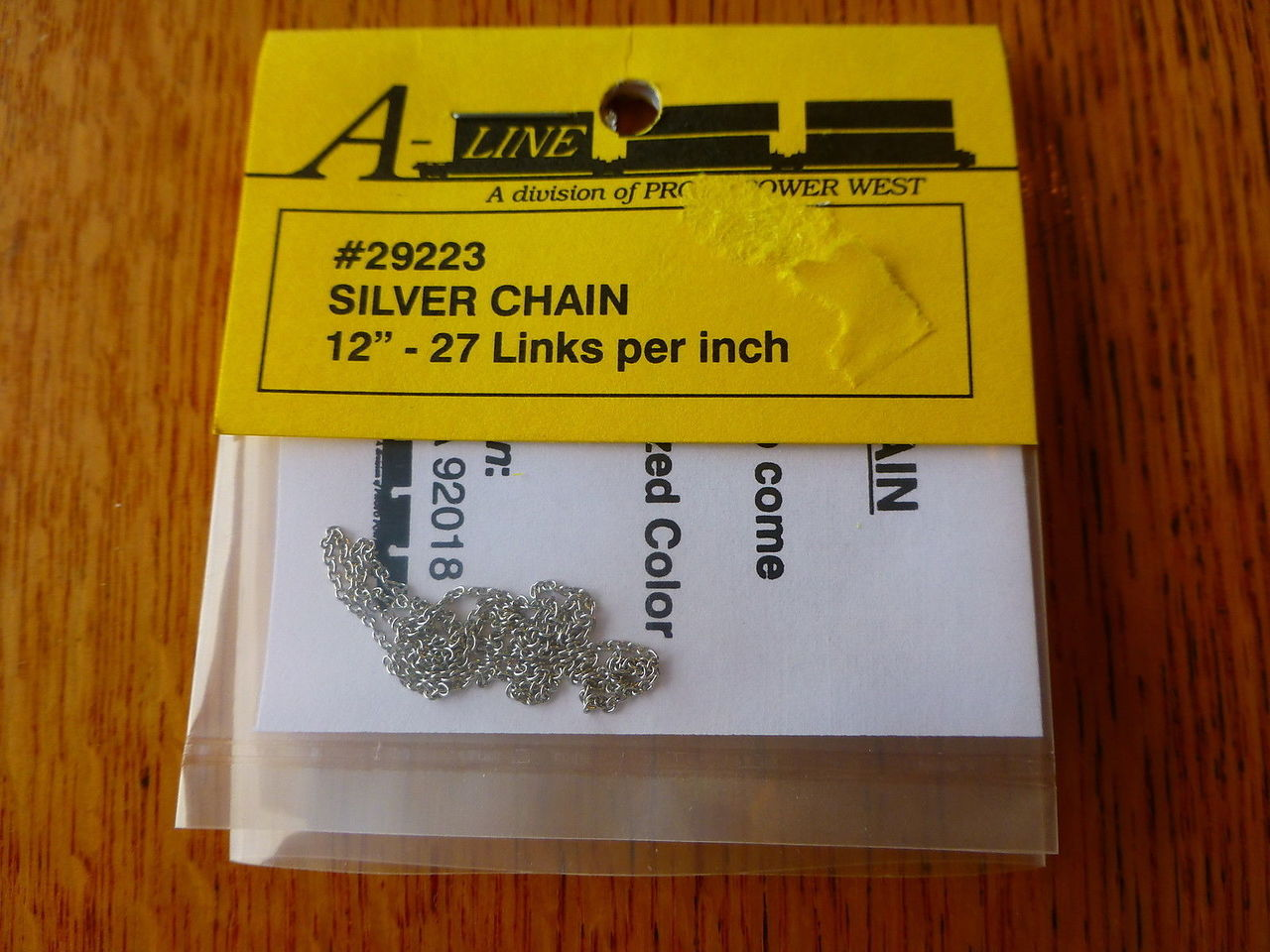 A-Line 29223 HO Silver Chain - 12 30.5cm 27 Links Per Inch This is an A-Line 29223 HO Scale Silver Chain - 12 30.5cm 27 Links Per Inch. Brass Chain (12) - Used to tie down open loads on freight cars, vehicle trailers and locomotive handrails. Brass chain is packaged in 12 inch lengths.Condition: Factory New (C-9All original; unused; factory rubs and evidence of handling, shipping and factory test run.Standards for all toy train related accessory items apply to the visual appearance of the item and do not consider the operating functionality of the equipment.Condition and Grading Standards are subjective, at best, and are intended to act as a guide. )Operational Status: FunctionalThis item is brand new from the factory.Original Box: Yes (P-9May have store stamps and price tags. Has inner liners.)Manufacturer: A-LineModel Number: 29223MSRP: $4.95Scale/Era: HO ModernModel Type: AccessoriesAvailability: Ships in 3 to 5 Business Days.The Trainz SKU for this item is P11973130. Track: 11973130 - FS - 001 - TrainzAuctionGroup00UNK - TDIDUNK