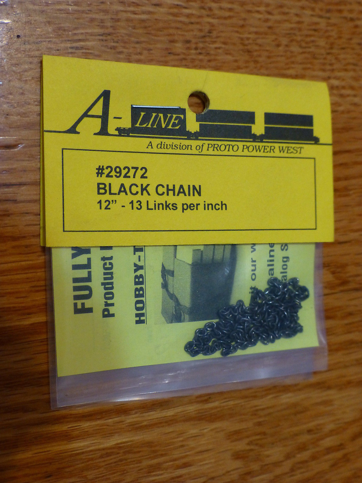 A-Line 29272 HO Tie Down Chain - Black 13 Links Per Inch This is an A-Line 29272 HO Scale Tie Down Chain - Black 13 Links Per Inch. Brass Chain (12) - Used to tie down open loads on freight cars, vehicle trailers and locomotive handrails. Brass chain is packaged in 12 inch lengths.Condition: Factory New (C-9All original; unused; factory rubs and evidence of handling, shipping and factory test run.Standards for all toy train related accessory items apply to the visual appearance of the item and do not consider the operating functionality of the equipment.Condition and Grading Standards are subjective, at best, and are intended to act as a guide. )Operational Status: FunctionalThis item is brand new from the factory.Original Box: Yes (P-9May have store stamps and price tags. Has inner liners.)Manufacturer: A-LineModel Number: 29272MSRP: $4.95Scale/Era: HO ModernModel Type: AccessoriesAvailability: Ships in 3 to 5 Business Days.The Trainz SKU for this item is P11953881. Track: 11953881 - FS - 001 - TrainzAuctionGroup00UNK - TDIDUNK