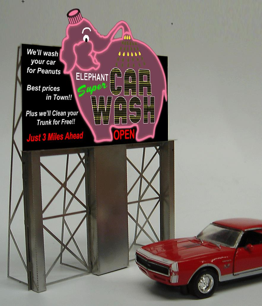 Miller Engineering 8381 HO/O Elephant Car Wash Billboard This is a Miller Engineering 8381 HO/O Scales Elephant Car Wash Billboard. Animated Billboards Add Realism to Any Railroad . These easy-to-build simulated neon billboards from Light Works USA are great for adding lights and action to your layout scenes. Each includes a thin-profile, lighted electroluminescent sign with moving arrows, flashing lights and more. Completely assembled electronics fit conveniently under your layout and a battery holder makes these kits a snap to install.Condition: Factory New (C-9All original; unused; factory rubs and evidence of handling, shipping and factory test run.Standards for all toy train related accessory items apply to the visual appearance of the item and do not consider the operating functionality of the equipment.Condition and Grading Standards are subjective, at best, and are intended to act as a guide. )Operational Status: FunctionalThis item is brand new from the factory.Original Box: Yes (P-9May have store stamps and price tags. Has inner liners.)Manufacturer: Miller EngineeringModel Number: 8381MSRP: $45.95Scale/Era: HO ModernModel Type: AccessoriesAvailability: Ships in 1 Business Day!The Trainz SKU for this item is P11588370. Track: 11588370 - No Location Assigned - 001 - TrainzAuctionGroup00UNK - TDIDUNK