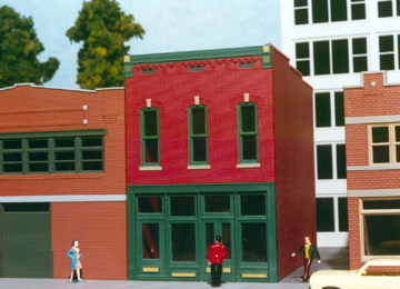 Smalltown USA 699-6015 Smalltown USA 6015 HO Furniture Showroom Kit This is a Smalltown USA 6015 HO Scale Furniture Showroom Kit - 9-1/2 x 4-1/8 24.2 x 10.5cm. Here's a big building that's right at home in your business district! Typical of large stores, it might be a department store, furrier or perhaps a small factory with a showroom. The finished model includes the large display windows and recessed entry and measures 69 scale feet across the front, by 30 scale feet deep.Condition: Factory New (C-9All original; unused; factory rubs and evidence of handling, shipping and factory test run.Standards for all toy train related accessory items apply to the visual appearance of the item and do not consider the operating functionality of the equipment.Condition and Grading Standards are subjective, at best, and are intended to act as a guide. )Operational Status: FunctionalThis item is brand new from the factory.Original Box: Yes (P-9May have store stamps and price tags. Has inner liners.)Manufacturer: Smalltown USAModel Number: 699-6015MSRP: $20.95Scale/Era: HO ModernModel Type: BuildingsAvailability: Ships in 1 Business Day!The Trainz SKU for this item is P12000079. Track: 12000079 - 1005-B (Suite 2740-200)  - 001 - TrainzAuctionGroup00UNK - TDIDUNK