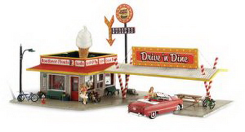 Woodland Scenics BR5029 HO Scale Built-Up Drive n' Dine Building Drive in to this beauty and you'll be transported back in time! The little diner features a huge ice cream cone on its roof, soda straw supports for the awning, two carhops, bikes, benches, a spilled trashcan and a lamppost. Includes great interior detailing and wiring for the light inside, you just hook it up!Condition: Factory New (C-9All original; unused; factory rubs and evidence of handling, shipping and factory test run.Standards for all toy train related accessory items apply to the visual appearance of the item and do not consider the operating functionality of the equipment.Condition and Grading Standards are subjective, at best, and are intended to act as a guide. )Operational Status: FunctionalThis item is brand new from the factory.Original Box: Yes (P-9May have store stamps and price tags. Has inner liners.)Manufacturer: Woodland ScenicsModel Number: BR5029MSRP: $94.99Scale/Era: HO ModernModel Type: BuildingsAvailability: Ships in 1 Business Day!The Trainz SKU for this item is P11543424. Track: 11543424 - 4016-F (Suite 2730-100)  - 001 - TrainzAuctionGroup00UNK - TDIDUNK