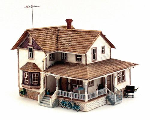 Woodland Scenics BR5046 HO Scale Built-Up Corner Porch House Building This is Woodland Scenics BR5046 HO B/U Corner Porch House. Set Built-&-Ready Structures on your layout right out of the box! These hand-painted and fully-detailed buildings are great for building cities, towns and villages. They are molded with high architectural detail and include realistic weathering, signs, fixtures and add-ons. Two-Story home with cedar-shake roof and a corner wrap-around porch. Beautifully weathered and loaded with details, such as a bicycle built for two, rocking chair and table, guttering, rain barrel, exterior cellar door and loads more! Colors may vary from actual product. Dimensions: 5 5/8 w x 8 5/8 d x 5 h (14.3cm w x 11.7cm d x 12.7cm h)Condition: Factory New (C-9All original; unused; factory rubs and evidence of handling, shipping and factory test run.Standards for all toy train related accessory items apply to the visual appearance of the item and do not consider the operating functionality of the equipment.Condition and Grading Standards are subjective, at best, and are intended to act as a guide. )Operational Status: FunctionalThis item is brand new from the factory.Original Box: Yes (P-9May have store stamps and price tags. Has inner liners.)Manufacturer: Woodland ScenicsModel Number: BR5046MSRP: $84.99Scale/Era: HO ModernModel Type: BuildingsAvailability: Ships in 1 Business Day!The Trainz SKU for this item is P11679886. Track: 11679886 - 1011-A (Suite 2740-200)  - 001 - TrainzAuctionGroup00UNK - TDIDUNK