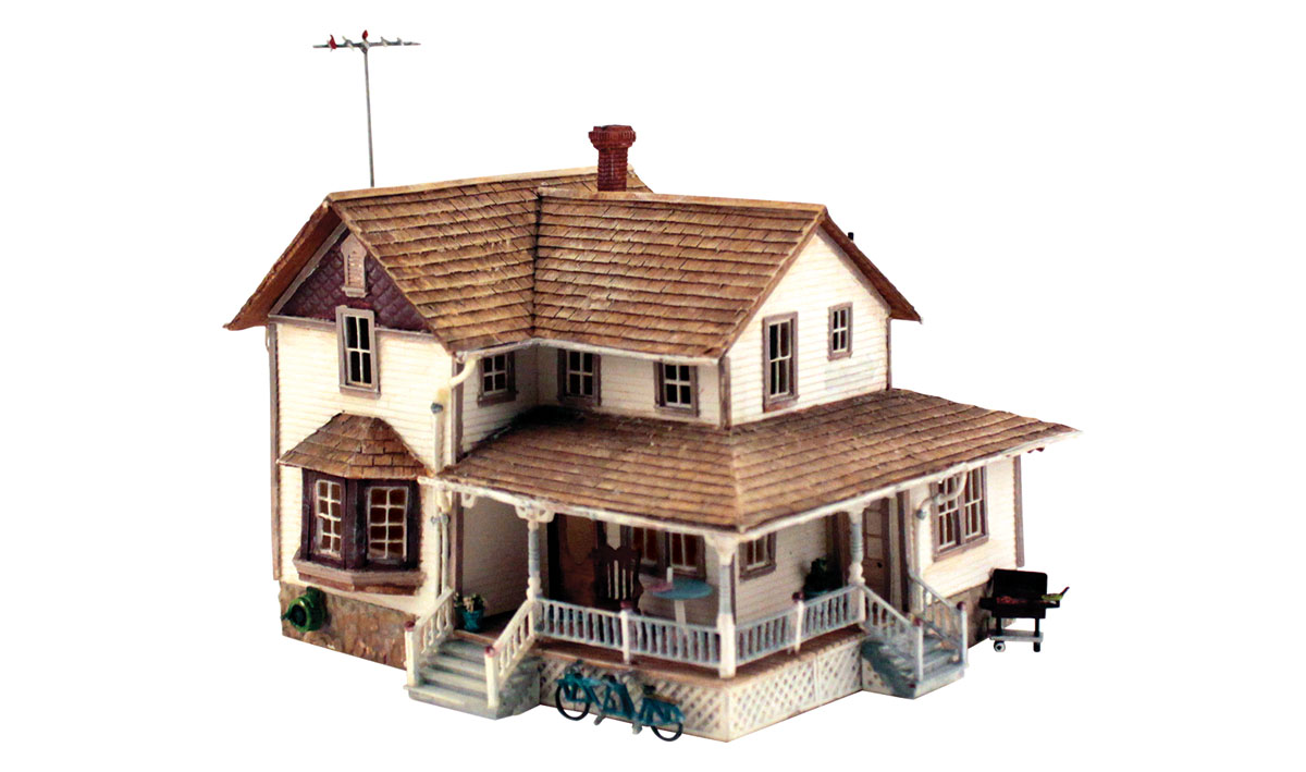 Woodland Scenics PF5196 HO Scale Corner Porch House Building Kit Two-story home with cedar-shake roof and a corner wrap-around porch. Clapboard siding, paned windows, and loaded with accessories, such as a bicycle built for two, rocking chair and table, guttering, rain barrel, exterior cellar door and many more! See photos for footprint.Colors may vary from actual product. Vehicles, figures and landscape sold separately.Condition: Factory New (C-9All original; unused; factory rubs and evidence of handling, shipping and factory test run.Standards for all toy train related accessory items apply to the visual appearance of the item and do not consider the operating functionality of the equipment.Condition and Grading Standards are subjective, at best, and are intended to act as a guide. )Operational Status: FunctionalThis item is brand new from the factory.Original Box: Yes (P-9May have store stamps and price tags. Has inner liners.)Manufacturer: Woodland ScenicsModel Number: PF5196MSRP: $59.99Scale/Era: HO ModernModel Type: BuildingsAvailability: Ships in 1 Business Day!The Trainz SKU for this item is P12103509. Track: 12103509 - No Location Assigned - 001 - TrainzAuctionGroup00UNK - TDIDUNK