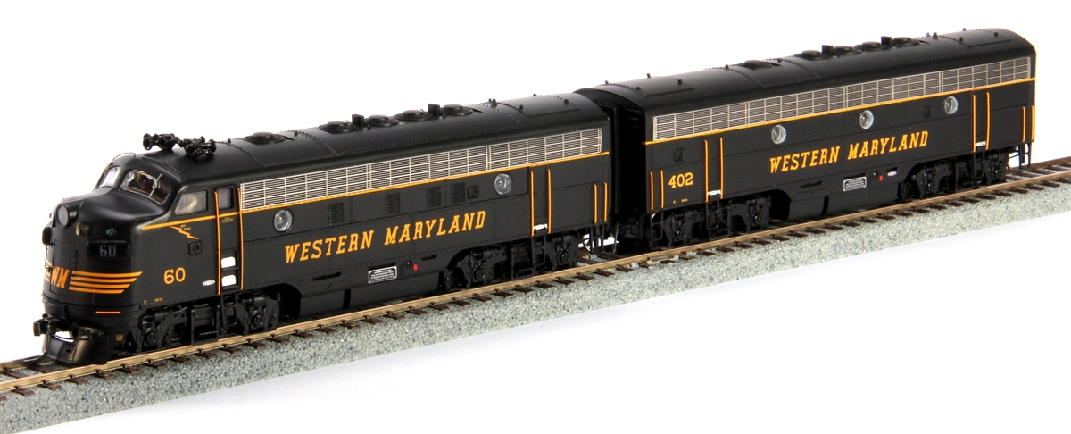 MTH 8021110 HO F7 A/B w/NMRA Socket, WM This is MTH 80-2111-0 HO F7 A/B w/NMRA Socket, WM. FA-7 A/B set (DCC ready), Western Maryland. A Unit number: 60. B Unit number: 402. Manufactured by the Electro-Motive division of GM (EMD) from 1949 to 1953, the F-7 was a welcome relief to the strict guidelines set in place by the War Production Board during WWII. By 1945 the war had ended and the restrictions were lifted. EMD took advantage of having no limitations on supplies and released their F-series locomotives that same summer. The EMD F-7 shared the same smooth faced pilots and coupler shrouds as the earlier F3, the only noticeable difference between the two was the F-7's modified primary internal equipments, and the replacement of the F-3's chicken wire grilles with stainless steel upper body grilles.This 1500hp diesel electric locomotive worked hard to meet industry demand after the four years of restriction during the war. Universally associated with North American railroads until the 1970's, EMD's F-7 continued to be used for decades as railroads found them inexpensive to operate and maintain. Originally introduced as a freight-hauling unit, by EMD, the F-7 was also frequently used in passenger service. The F-7 wound up being the best selling carbody-style diesel EMD ever produced, selling over 3,700 units to 49 different railroads. They stayed in service until 1970 and assured itself a place in the railroad record books as a triumph of diesel productivity.M.T.H. is proud to offer the drama of this postwar locomotive in HO scale. The M.T.H. HO FA-2 Diesel Sets include Proto Sound 3.0 offering authentic EMD 567 prime mover sounds, first generation diesel horn and bell, crew station sounds, break sounds, and cab chatter. The F7 features superb detailing that characterizes all M.T.H. HO diesels, with added-on details that include legible builder's plates, grab irons, multiple-unit hoses, rooftop lift rings, see-through rooftop fans
