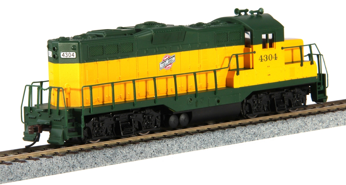 Walthers 931-134 HO Chicago & North Western EMD GP9M Standard DC #4304 This is a WalthersTrainline 931-134 HO Scale EMD GP9M - Standard DC Chicago & North Western(TM) #4304 (yellow, green). The Electro-Motive Division (EMD) of General Motors was the last major builder to enter the road switcher market, introducing the GP7 (GP for General Purpose) in 1949. In 1954, the more powerful GP9 was unveiled with a 1750 horsepower prime-mover. This became the most successful of the early geeps, with sales of more than 3,800 locos in the U.S. and Canada. As the GP9s were bumped from major freight and passenger trains by newer locos, they began new careers as switchers. Many roads rebuilt them with a low nose to improve forward visibility and they continue to serve in switching, wayfreight and transfer assignments today. This model will be a real workhorse on your model railroad, with great features like a heavy die cast metal frame, powerful can motor with flywheel, eight-wheel electrical pickup and drive, and a working headlight. Fully assembled and ready for service, they come prepainted in a variety of schemes.  Condition: Factory New (C-9All original; unused; factory rubs and evidence of handling, shipping and factory test run.Standards for all toy train related accessory items apply to the visual appearance of the item and do not consider the operating functionality of the equipment.Condition and Grading Standards are subjective, at best, and are intended to act as a guide. )Operational Status: FunctionalThis item is brand new from the factory.Original Box: Yes (P-9May have store stamps and price tags. Has inner liners.)Manufacturer: WalthersModel Number: 931-134Road Name: Chicago & North WesternMSRP: $69.98Scale/Era: HO ModernModel Type: Diesel LocoAvailability: Ships in 3 to 5 Business Days.The Trainz SKU for this item is P12110294. Track: 12110294 - FS - 001 - TrainzAuctionGroup00UNK - TDIDUNK