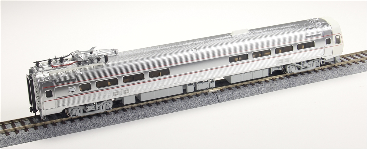 Walthers 920-14803 HO Pennsylvania Budd Metroliner Electric Multiple U This is a WalthersProto 920-14803 HO Scale Budd Metroliner Electric Multiple Unit Snack Bar Coach - Tsunami Sound & DCC Pennsylvania (As-Delivered), Penn Central & Amtrak Patches. Features: - Pennsylvania, Amtrak & Penn Central Decals for Cars in As-Delivered Paint - As-Built Gray, Red & Stainless Scheme for Pennsylvania, or Penn Central & Amtrak Patched Units with Decals for Seven Authentic Schemes: Black PC Logo - No Background Black PC Logo on Silver Background Black PC Logo on White Background White PC Logo on Black Background Black PC Logo, White Name on Green Background Amtrak - Early Single Arrow Logo on White Background Pennsylvania - As-Delivered Keystone Logo - Factory-Installed Soundtraxx(R) Tsunami(R) Sound for Operation on DCC or DC Layouts - New Decal Unit Numbers - Based on Equipment in Service 1968-1982 - 3 Prototype Car Styles - One Helical Geared Power Truck & Skew-Wound High Torque Motor in Each Unit - Working Headlight, Gyralight, Reversing A-End Red Marker Lights, Number Boards & Interior Lighting - Detailed, Spring-Loaded GE or Westinghouse Pantographs per Prototype - Real Metal Finish Simulates Stainless Steel - Correct A & B End Details - Factory-Installed Steel Grab - Prototypically Accurate Window Tinting - Proto MAX(TM) Metal Knuckle Couplers.Flashing by at 100+mph, Metroliners symbolized American high-speed rail service for years, serving business travelers on Penn Central and later Amtrak as the fastest scheduled trains in the western hemisphere! Now these history-making trains are back in authentic HO Scale as only Walthers can, with the all-new WalthersProto Metroliner. Just as the prototypes broke new ground in style and technology, so do our Metroliners! Completely new from roof to rails, we've captured the unique shape of the Coach, Snack Bar Coach and Parlor Car in all-new tooling. Each comes fully assembled with Walthers real metal stainless steel finish comple