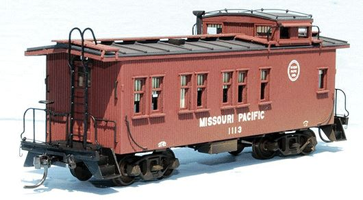 American Model Builders 883 HO Missouri Pacific Drover's Car 1100-1119 This is an American Model Builders 883 HO Missouri Pacific Drover's Car 1100-1119 Series Wood Caboose Kit Laser-Cut Wood. Accurate laser-cut wood constructed caboose body kits ready for detailing. Trucks, couplers, ladders and decals not included. To further enhance these kits, Detail Associates produces an AMB Caboose Detail Kit (#229-550, sold separately) with ladders and pre-bent wire grab irons. In 1930, the Missouri Pacific ordered 20 drover cabooses, series 1100-1119 from St. Louis Car Company (order number 1534). Besides their normal freight train duties, these cars had seating and sleeping space for men accompanying cattle shipped on the MP. Measuring 42 feet over the coupler pulling faces, the cars were longer than standard MP cabooses. All were off the roster by 1965. This kit represents the as-built version, used through WWII. Photo shows assembled and painted model - assembly required.Condition: Factory New (C-9All original; unused; factory rubs and evidence of handling, shipping and factory test run.Standards for all toy train related accessory items apply to the visual appearance of the item and do not consider the operating functionality of the equipment.Condition and Grading Standards are subjective, at best, and are intended to act as a guide. )Operational Status: FunctionalThis item is brand new from the factory.Original Box: Yes (P-9May have store stamps and price tags. Has inner liners.)Manufacturer: American Model BuildersModel Number: 883Road Name: Missouri PacificMSRP: $61.95Scale/Era: HO ModernModel Type: Freight CarsAvailability: Ships in 3 to 5 Business Days.The Trainz SKU for this item is P11643918. Track: 11643918 - FS - 001 - TrainzAuctionGroup00UNK - TDIDUNK