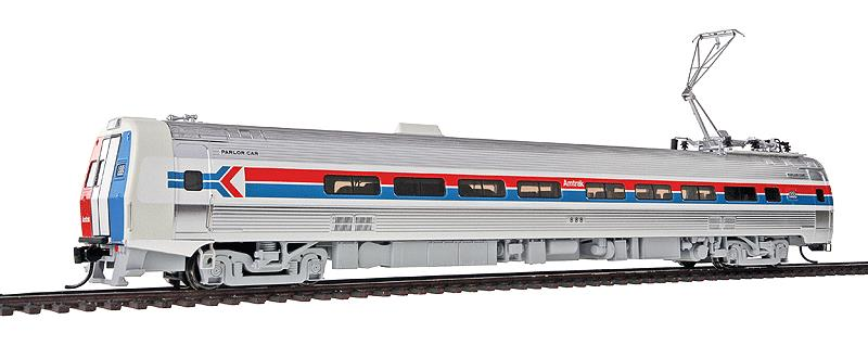 Walthers 920-13821 HO Amtrak Budd Metroliner Electric Multiple Unit #8 This is Walthers 13821 Mtlnr Parlor DC AMTK #888. WalthersProto Budd Metroliner Electric Multiple Unit (EMU) parlor car, standard DC. Amtrak® #888 (Phase I, wide red & blue stripes). Flashing by at 100+mph, Metroliners symbolized American high-speed rail service for years, serving business travelers on Penn Central and later Amtrak as the fastest scheduled trains in the western hemisphere!Just as the prototypes broke new ground in style and technology, so do our Metroliners! Completely new from roof to rails, we've captured the unique shape of the Coach, Snack Bar Coach and Parlor Car in all-new tooling.Each comes fully assembled with Walthers real metal stainless steel finish complemented by ultra-sharp Amfleet Phase I paint and lettering including factory-printed car numbers. Fine details, from a full underbody to installed grab irons, from prototypically tinted windows to sprung General Electric or Westinghouse pantographs as appropriate, are all included. Powered by the proven technology of WalthersProto locos, each car has its own high torque motor, driving a powered truck with helical gears, and comes in dual mode Tsunami Sound & DCC (sound operates on DC) or Standard DC versions for every layout.Its key features are:Based on equipment in service 1968-1982All-new tooling for 3 prototype car stylesOne helical geared power truck & skew-wound high torque motor in each unitWorking headlight, gyralight, reversing a-end red marker lights, number boards & interior lightingClassic Amfleet Phase I scheme on standard edition carsDetailed, spring-loaded GE or Westinghouse pantographs per prototypeReal metal finish simulates stainless steelCorrect A & B end detailsAll grab irons factory installedFactory-printed road numbersPrototypically accurate window tintingAvailable with factory-installed Tsunami® Sound & DCC (sound operates on DC)Proto MAX™ metal knuckle couplersPLEASE NOTE: As these ca