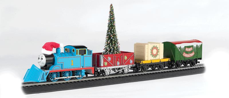 """Bachmann 00721 HO Thomas & Friends Christmas Express Train Set This is Bachmann 00721 HO Thomas' Christmas Express Freight Set. Sporting a merry hat and equipped with a snow plow, Thomas is ready to brave the winter weather to make sure the Christmas tree and important cargo arrive on time for the Island of Sodor holiday party. The festive Thomas' Christmas Express will deliver Yuletide fun to children of all ages! This ready-to-run train set includes: Thomas the Tank EngineTM with plow, holiday hat, and moving eyes Open Wagon with decorated tree and international-style hook and loop couplers Flat Car with Crated Load and international-style hook and loop couplers """"Merry Christmas"""" Ventilated Van with international-style hook and loop couplers 56 x 38 oval of snap-fit E-Z Track® with 12 pieces of curved track, 3 pieces of straight track, and 1 straight plug-in terminal rerailer Power pack and speed controller Illustrated instruction manualCondition: Factory New (C-9All original; unused; factory rubs and evidence of handling, shipping and factory test run.Standards for all toy train related accessory items apply to the visual appearance of the item and do not consider the operating functionality of the equipment.Condition and Grading Standards are subjective, at best, and are intended to act as a guide. )Operational Status: FunctionalThis item is brand new from the factory.Original Box: Yes (P-9May have store stamps and price tags. Has inner liners.)Manufacturer: BachmannModel Number: 00721Road Name: ThomasMSRP: $235.00Scale/Era: HO ModernModel Type: Sets ScaleAvailability: Ships in 2 Business Days!The Trainz SKU for this item is P11725355. Track: 11725355 - No Location Assigned - 001 - TrainzAuctionGroup00UNK - TDIDUNK"""