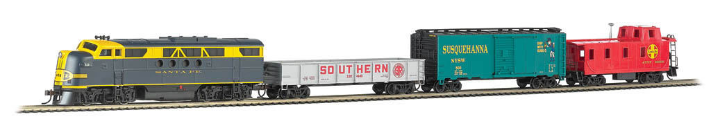 Bachmann 01501 HO Santa Fe Blue Lightning Diesel Freight Train Set wit Set features wireless control with any Bluetooth® 4-supported iPhone®, iPad®, or iOS device (includes iPhone® 4s, 5, 5c, 5s, 6, and 6 Plus; iPad Air® and iPad mini™, 3rd and 4th generations; and iPod touch® 5 or newer). Operates from up to 100 feet away with Bluetooth® Smart technology. Realistic, dynamic engine sound broadcast through your Bluetooth® 4-supported smart device. Requires 16 volt DC or DCC track power for operation. Inclues 40' box car, gondola, off-center caboose , 56 x 38 oval of snap-fit nickel silver E-Z Track® including 12 pieces of curved track, 3 pieces of straight track, and 1 plug-in terminal rerailer, wall power pack and illustrated instructions.Condition: Factory New (C-9All original; unused; factory rubs and evidence of handling, shipping and factory test run.Standards for all toy train related accessory items apply to the visual appearance of the item and do not consider the operating functionality of the equipment.Condition and Grading Standards are subjective, at best, and are intended to act as a guide. )Operational Status: FunctionalThis item is brand new from the factory.Original Box: Yes (P-9May have store stamps and price tags. Has inner liners.)Manufacturer: BachmannModel Number: 01501Road Name: Santa FeMSRP: $315.00Scale/Era: HO ModernModel Type: Sets ScaleAvailability: Ships in 1 Business Day!The Trainz SKU for this item is P12104676. Track: 12104676 - No Location Assigned - 001 - TrainzAuctionGroup00UNK - TDIDUNK