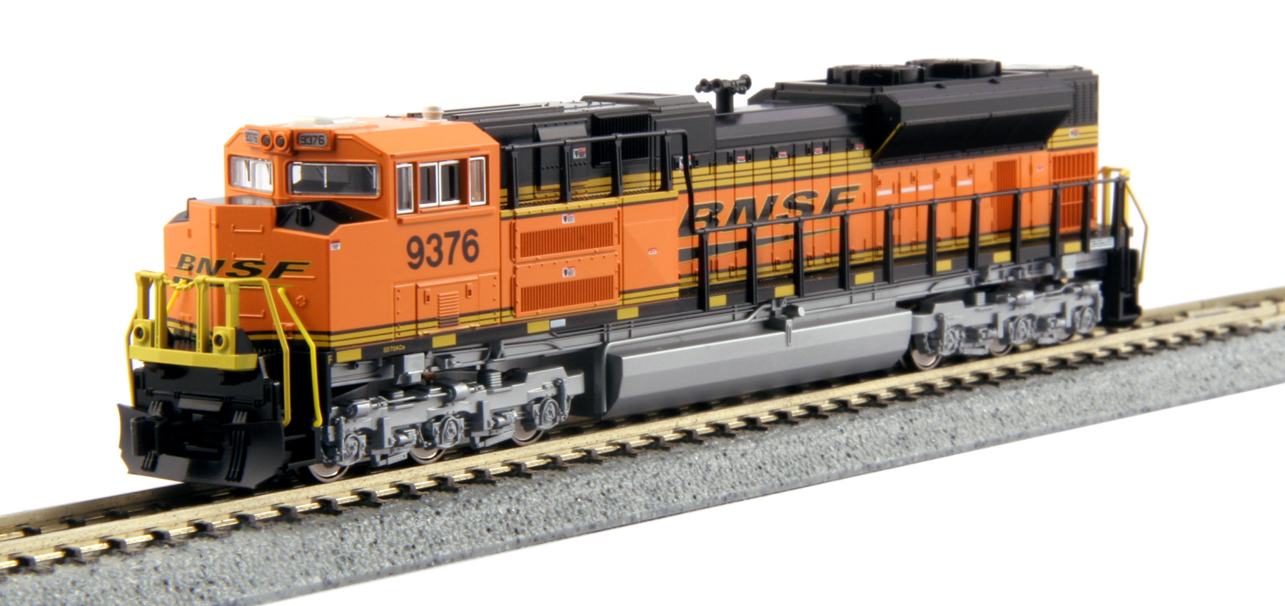Kato 176-8434 N BNSF  Swoosh  EMD SD70ACe #9376 This is a Kato 176-8434 N Scale BNSF Swoosh EMD SD70ACe #9376. The SD70ACe is the latest in the line of EMD's 70 locomotives, an evolution of the SD70MAC, although its radiator design harkens more to that of the SD80/90 body. The SD70ACe has been designed to fit the latest EPA standards and regulations, and sports 4300 horsepower. The Union Pacific is one of the largest original buyers of EMD's new ACe units, and continues to add more to their roster. Model Features: Powerful Kato mechanism powered by a 5-pole flywheel motor and featuring a 9 3/4 minimum turning radius. Directional Headlight and illuminated, preprinted numberboards. Illuminated ditch lights. DCC Friendly mechanism ready for drop-in decoder installation.Condition: Factory New (C-9All original; unused; factory rubs and evidence of handling, shipping and factory test run.Standards for all toy train related accessory items apply to the visual appearance of the item and do not consider the operating functionality of the equipment.Condition and Grading Standards are subjective, at best, and are intended to act as a guide. )Operational Status: FunctionalThis item is brand new from the factory.Original Box: Yes (P-9May have store stamps and price tags. Has inner liners.)Manufacturer: KatoModel Number: 176-8434Road Name: BNSFMSRP: $130.00Scale/Era: N ScaleModel Type: Diesel LocoAvailability: Ships in 1 Business Day!The Trainz SKU for this item is P12170800. Track: 12170800 - No Location Assigned - 001 - TrainzAuctionGroup00UNK - TDIDUNK