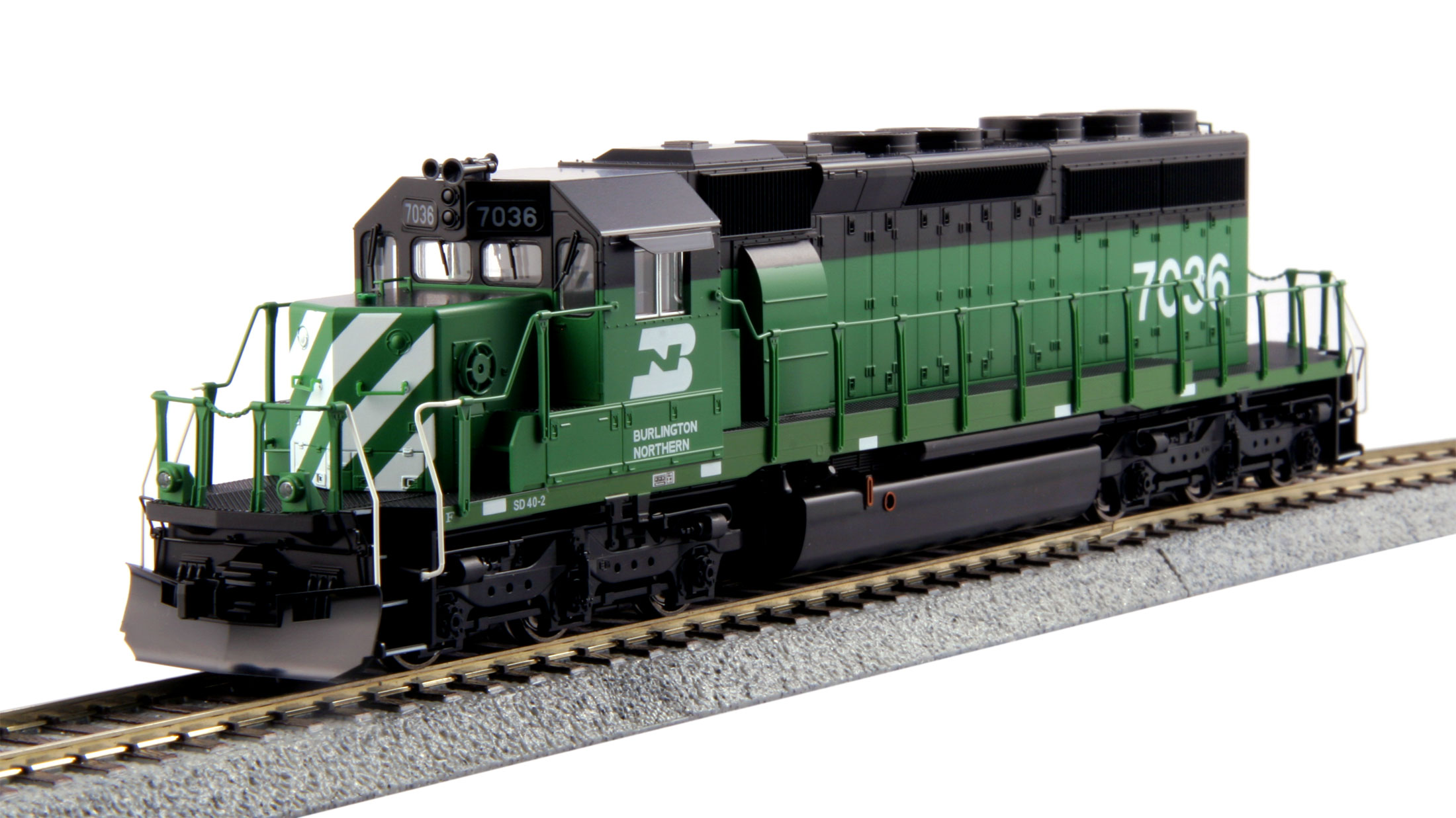 Kato 37-6604 HO Burlington Northern EMD SD40-2 Mid Cab Headlight #7036 This is a Kato 37-6604 HO Scale Burlington Northern EMD SD40-2 Mid Cab Headlight Standard #7036. Model Features: All handrails and grab irons are factory installed, making the model ready to go out of the box, Functional ditch lights that can be switched between alternating and steady modes on-the-fly, Great for pulling our Gunderson MAXI-IV double stack well cars, Locomotives feature directional Golden White LED headlights and illuminated preprinted numberboards, Sound friendly construction with a speaker housing in the fuel tank and Ditch lights can be synchronized with horn or bell functions with the installation of an 8-pin sound decoder.Condition: Factory New (C-9All original; unused; factory rubs and evidence of handling, shipping and factory test run.Standards for all toy train related accessory items apply to the visual appearance of the item and do not consider the operating functionality of the equipment.Condition and Grading Standards are subjective, at best, and are intended to act as a guide. )Operational Status: FunctionalThis item is brand new from the factory.Original Box: Yes (P-9May have store stamps and price tags. Has inner liners.)Manufacturer: KatoModel Number: 37-6604Road Name: Burlington NorthernMSRP: $185.00Scale/Era: HO ModernModel Type: Diesel LocoAvailability: Ships in 1 Business Day!The Trainz SKU for this item is P12163211. Track: 12163211 - No Location Assigned - 001 - TrainzAuctionGroup00UNK - TDIDUNK