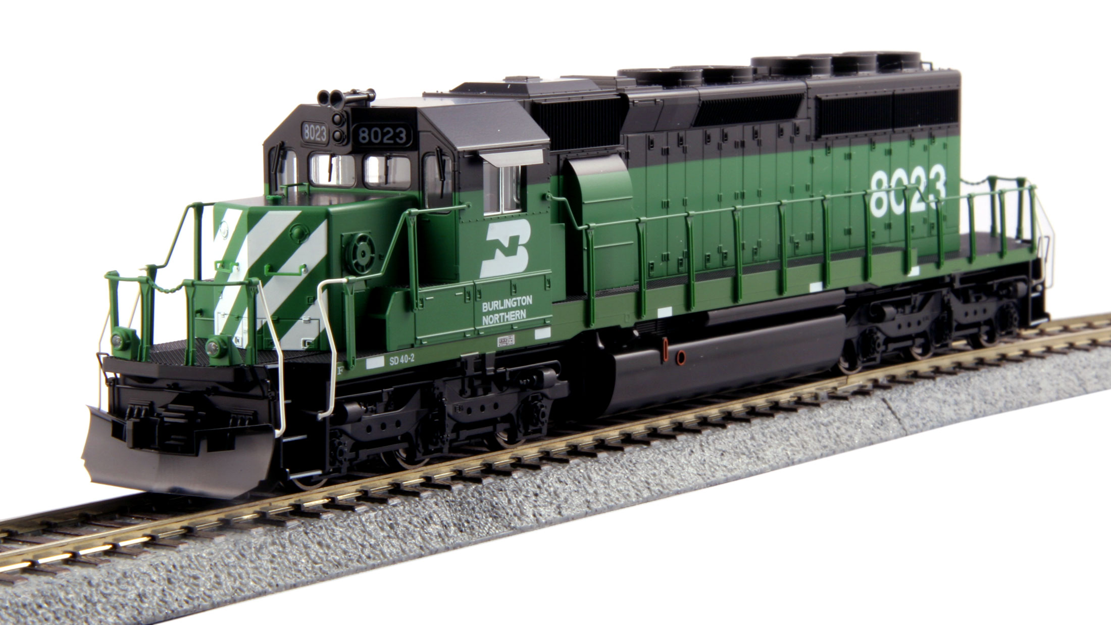 Kato 37-6605 HO Burlington Northern EMD SD40-2 Mid Cab Headlight #8023 This is a Kato 37-6605 HO Scale Burlington Northern EMD SD40-2 Mid Cab Headlight Standard #8023. Model Features: All handrails and grab irons are factory installed, making the model ready to go out of the box, Functional ditch lights that can be switched between alternating and steady modes on-the-fly, Great for pulling our Gunderson MAXI-IV double stack well cars, Locomotives feature directional Golden White LED headlights and illuminated preprinted numberboards, Sound friendly construction with a speaker housing in the fuel tank and Ditch lights can be synchronized with horn or bell functions with the installation of an 8-pin sound decoder.Condition: Factory New (C-9All original; unused; factory rubs and evidence of handling, shipping and factory test run.Standards for all toy train related accessory items apply to the visual appearance of the item and do not consider the operating functionality of the equipment.Condition and Grading Standards are subjective, at best, and are intended to act as a guide. )Operational Status: FunctionalThis item is brand new from the factory.Original Box: Yes (P-9May have store stamps and price tags. Has inner liners.)Manufacturer: KatoModel Number: 37-6605Road Name: Burlington NorthernMSRP: $185.00Scale/Era: HO ModernModel Type: Diesel LocoAvailability: Ships in 1 Business Day!The Trainz SKU for this item is P12163213. Track: 12163213 - No Location Assigned - 001 - TrainzAuctionGroup00UNK - TDIDUNK