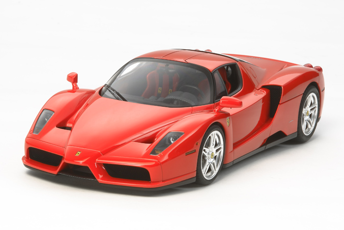 Tamiya 24327 1/24 Enzo Ferrari Car w/Detail Up Parts This is Tamiya 24327 1/24 Enzo Ferrari Car w/Detail Up Parts. The Enzo Ferrari, named for the legendary car company's founder, debuted to an awed audience at the Paris Motor Show in 2002. The company drew on all of its knowledge gleaned from Formula One racing in designing and building this modern super premium sports car. It featured a carbon composite monocoque, a 6-liter V12 engine capable of producing 650hp, and suspension-wise it used a pushrod double wishbone system with inboard dampers. All of this was contained in an aerodynamic carbon fiber body penned by Pininfarina, a design firm with a long history of styling Ferrari cars.Its key features are:1/24 scale plastic assembly model kitLength: 197mm, Width: 93mmIncludes photo-etched parts to depict pedals, foot-rest surfaces, engine grille meshes and windshield wipersAlso comes with metal exhaust tips and seatbelt stickers in 3 colors (red, yellow, and black)Highly-detailed 65°V12 engine is built into the sub-frame and assembled as part of the monocoqueFront suspension has been accurately converted into model formFeatures a simple yet functional interiorPanels are attached to the monocoque individually for a realistic finish, and rear diffuser faithfully reproduce those on the real carModellers can choose between black or clear rear underpanelDoors and rear cowling can be opened to showcase the details of the modelCarbon-pattern decals provide a final realistic touchPaints needed: Italian Red, Semi-Gloss Black, Black, Red, Chrome Silver, Gold Leaf, Titanium Gold, Titanium Silver, Flat Black, Flat White, Flat Red, Flat Aluminum, Sky Gray, Metallic Gray, White Fine Surface PrimerCondition: Factory NewOperational Status: FunctionalThis item is brand new from the factory.Original Box: YesManufacturer: TamiyaModel Number: 24327MSRP: $92.00Category 1: Model KitsCategory 2: 1:24 ScaleAvailability: Ships in 1 Busines