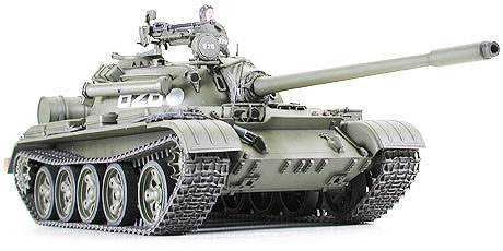 Tamiya 35257 1/35 T55A Russian Med Tank Tamiya presents the Russian Medium Tank T-55 of which about 10,000 units, including T-54, that served as a base for its development, and derivatives were produced during the Cold War era as a 1/35 scale plastic model. Every characteristic of this tank, low-profile hull, and compact hemispherical turret, powerful main gun, has been accurately reproduced. Details such as welding lines, cast iron appearance, 12.7mm anti-aircraft machinegun and protective cover on tank commander have been crisply molded. This historically important tank is a must-have for any post WWII era tank collector. About the T-55A The low clearance chassis has been replicated down to the finest detail, even the cast iron surface of the tank has been faithfully recreated. The characteristic half sphere turret and powerful 100mm cannon are faithfully portrayed. Not a detail has been spared, even with finer parts such as the engine grill and cast iron wheels. This kit will let you choose between two extensively used types for assembly, the T-55A with anti-radiation armoring and the DShK-M anti-aircraft machinegun. And the options don?t stop there. The modeler can also chose parts for replication of the tank as it was produced in Communist Russia, or Czechoslovakia and Poland with river crossing snorkel and headlight. Decals for recreation of 5 different tanks are planned to be included in the kit. One tank commander figure posted on cupola is also planned to be featured in kit. T-55 production began in 1958, as opposition between western countries and the Soviet Union grew. It was easy to produce and featured an oblique front hull wall, a compact hull and a semi-spherical turret to limit vulnerability. The T-55 was also well armed with a 100mm main gun. In the early 60's, the T-55A with anti-radiation internal liner and anti-radiation cover on the tank commander cupola was developed. T-55 and T-55A were also license built by Czechos