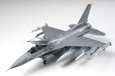 Tamiya 61098 1/48 F16CJ Block 50 Fighting Falcon Aircraft The F-16 is one of the world's top lightweight multi-role fighter aircraft. Since first deployment to U.S. Air Force (USAF) units in the late 1970's, total production numbers have exceeded 4,000, making it the second most highly produced jet fighter plane following the F-4 Phantom. The latest F-16 variant deployed to USAF units, the F-16C Block 50, is capable of precision night and all-weather bombing, and features advanced digital electronics for radar and cockpit displays. The slight variant, the F-16CJ (Block 50), is fitted with HARM Targeting System (HTS) and is used specifically for SEAD (Suppression of Enemy Air Defenses) missions. The F-16CJ (Block 50) has flown SEAD missions over Iraq while monitoring the northern and southern no-fly zones and during Operation Iraqi Freedom. About the Model Model represents the F-16CJ (Block 50) as used for USAF SEAD missions. Sleek fuselage including aerodynamic blended wing body design accurately reproduced. Accurately curved bubble top canopy can be assembled in the opened or closed position. Horizontal stabilizers are movable and flaperons can be modeled in both the up or down positions. A range of weapons and accessories are included such as HARM, AMRAAM, and Sidewinder missiles (M & X variants), detachable external fuel tanks, ECM pod, and HTS pod. One pilot figure included and can be depicted with either standard or JHMCS flight helmet. Detailed markings for 3 aircraft, including the 5th Air Force commander's aircraft stationed at Misawa airbase in 2005, are included.Condition: Factory NewOperational Status: FunctionalThis item is brand new from the factory.Original Box: YesManufacturer: TamiyaModel Number: 61098MSRP: $66.00Category 1: Model KitsCategory 2: 1:48 ScaleAvailability: Ships in 1 Business Day!The Trainz SKU for this item is P12000647. Track: 12000647 - 4034-B (Suite 2730-100)  - 001 - TrainzAuctionGroup00UNK - TDIDUNK
