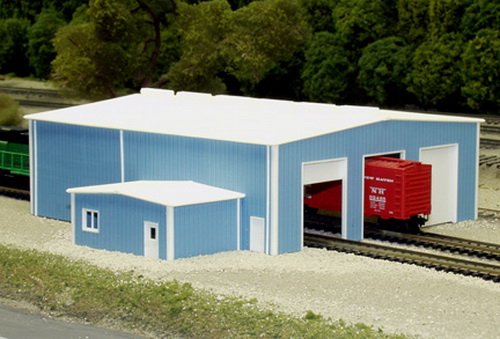 Pikestuff 541-8014 The Shops This is a Pikestuff 541-8014 N Scale The Shops 70' x 80' (blue) This kit is designed to be built 24 scale feet high. Side walls have cut lines for optional door openings. End walls have 3 enginehouse doors provided on front and rear walls. Office portion is 20 X 30 and the location and height is optional. Kit includes doors, windows, roof top vents, and down spouts.Condition: Factory New (C-9All original; unused; factory rubs and evidence of handling, shipping and factory test run.Standards for all toy train related accessory items apply to the visual appearance of the item and do not consider the operating functionality of the equipment.Condition and Grading Standards are subjective, at best, and are intended to act as a guide. )Operational Status: FunctionalThis item is brand new from the factory.Original Box: Yes (P-9May have store stamps and price tags. Has inner liners.)Manufacturer: PikestuffModel Number: 541-8014MSRP: $29.95Scale/Era: N ScaleModel Type: BuildingsAvailability: Ships in 2 Business Days!The Trainz SKU for this item is P11516594. Track: 11516594 - No Location Assigned - 001 - TrainzAuctionGroup00UNK - TDIDUNK