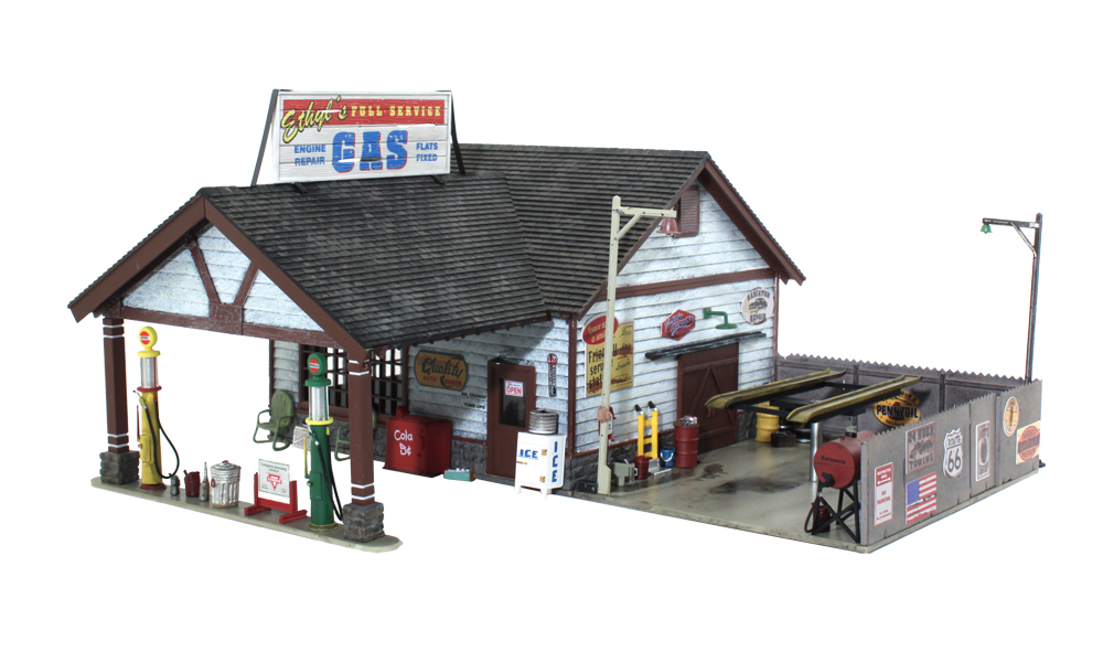 Woodland Scenics BR4935 N Scale Built-Up Ethyl's Gas & Service Buildin This is Woodland Scenics BR4935 N B/U Ethyl's Gas & Service. This vintage gas and service station with its open-beamed overhang, the old globed gas pumps, decals, signage and scene-setting detail is loaded with charm and nostalgia. Details include trash cans, an old bench and chair, cola machine, ice machine and pallets of old junk and car parts. The fenced outdoor service area features an oil-stained concrete floor, a lift, free-standing kerosene tank, old tires, dolly, pole lights and loads more. Dimensions: 3 1/2'' w x 3 1/8'' d x 1 7/8'' h (8.89cm w x 7.93cm d x 4.76cm h)Condition: Factory New (C-9All original; unused; factory rubs and evidence of handling, shipping and factory test run.Standards for all toy train related accessory items apply to the visual appearance of the item and do not consider the operating functionality of the equipment.Condition and Grading Standards are subjective, at best, and are intended to act as a guide. )Operational Status: FunctionalThis item is brand new from the factory.Original Box: Yes (P-9May have store stamps and price tags. Has inner liners.)Manufacturer: Woodland ScenicsModel Number: BR4935MSRP: $69.99Scale/Era: N ScaleModel Type: BuildingsAvailability: Ships in 1 Business Day!The Trainz SKU for this item is P11970001. Track: 11970001 - 1012-D (Suite 2740-200)  - 001 - TrainzAuctionGroup00UNK - TDIDUNK