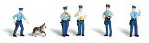 Woodland Scenics A2122 N Scale Policemen Figures (6) This set includes five officers and one canine cop. One of the officers is full-figured and eating a doughnut, while another is writing a ticket. One officer, with his hand on his gun, ready to draw, is being led by his faithful dog. One is directing traffic and another is walking the beat with his nightstick, smacking it onto his open hand.Condition: Factory New (C-9All original; unused; factory rubs and evidence of handling, shipping and factory test run.Standards for all toy train related accessory items apply to the visual appearance of the item and do not consider the operating functionality of the equipment.Condition and Grading Standards are subjective, at best, and are intended to act as a guide. )Operational Status: FunctionalThis item is brand new from the factory.Original Box: Yes (P-9May have store stamps and price tags. Has inner liners.)Manufacturer: Woodland ScenicsModel Number: A2122MSRP: $13.99Scale/Era: N ScaleModel Type: FiguresAvailability: Ships within 3 Business Days!The Trainz SKU for this item is P11542937. Track: 11542937 - 4026-D (Suite 2730-100)  - 001 - TrainzAuctionGroup00UNK - TDIDUNK