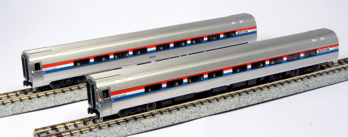 """Kato 106-6291 N Amtrak PhIII Amfleet Coach/2pk This is Kato 106-6291 N Amtrak PhIII Amfleet Coach/2pk. Introduced in 1981, the Amfleet II (sometimes affectionately called """"Amtube"""" by enthusiasts due to its distinct, rounded form) was introduced right in the middle of the EMD F40PH's life cycle in Amtrak service. Boasting larger windows and more comfortable seating conditions, the Amfleet II was designed for longer distance travel than its predecessor, the Amfleet I, while still retaining the versatility that its single-level height could provide over its taller, double-decker Superliner brethren.This new production of N EMD F40PH Phase III units fits these Amtrak locomotives with ditch lights and cab air conditioners – additions that came late in the F40PH's service lifetime with Amtrak. This allows modelers to recapture their memories of Amtrak's recent history while enjoying its iconic Phase III appearance along with matching Amfleet II cars, available in Phase III paint for the first time!Set includes:Amfleet II Coach Phase III #25023Amfleet II Coach Phase III #25056Condition: Factory New (<span class= tooltip  style= text-decoration: underline; color: blue;  title= C-9: All original; unused; factory rubs and evidence of handling, shipping and factory test run.Standards for all toy train related accessory items apply to the visual appearance of the item and do not consider the operating functionality of the equipment.Condition and Grading Standards are subjective, at best, and are intended to act as a guide. >C-9)Operational Status: FunctionalOriginal Box: Yes (P-9)Manufacturer: KatoModel Number: 106-6291MSRP: $55.00Scale/Era: N ScaleModel Type: Passenger CarsAvailability: Ships in 1 Business Day!The Trainz SKU for this item is P11663325. Track: 11663325 - No Location Assigned - 001 - TrainzAuctionGroup00UNK - TDIDUNK"""