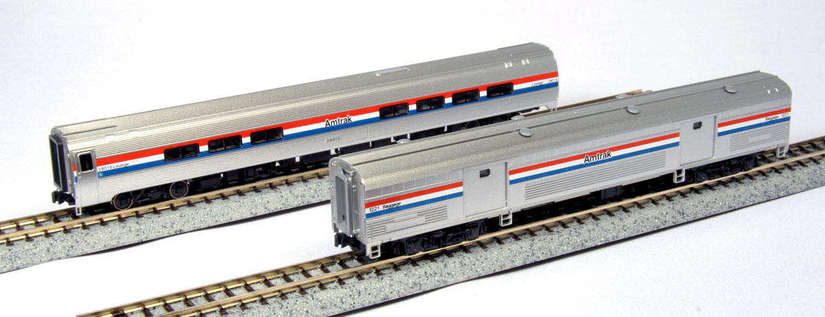 """Kato 106-6292 N Amtrak PhIII Amfleet Baggage & Cafe Car/2pk This is Kato 106-6292 N Amtrak PhIII Amfleet Baggage & Cafe Car/2pk. Introduced in 1981, the Amfleet II (sometimes affectionately called """"Amtube"""" by enthusiasts due to its distinct, rounded form) was introduced right in the middle of the EMD F40PH's life cycle in Amtrak service. Boasting larger windows and more comfortable seating conditions, the Amfleet II was designed for longer distance travel than its predecessor, the Amfleet I, while still retaining the versatility that its single-level height could provide over its taller, double-decker Superliner brethren.This new production of N EMD F40PH Phase III units fits these Amtrak locomotives with ditch lights and cab air conditioners – additions that came late in the F40PH's service lifetime with Amtrak. This allows modelers to recapture their memories of Amtrak's recent history while enjoying its iconic Phase III appearance along with matching Amfleet II cars, available in Phase III paint for the first time!Set includes:Amfleet II Coach-Café Phase III #28015Amtrak Baggage Car Phase III #1221Condition: Factory New (<span class= tooltip  style= text-decoration: underline; color: blue;  title= C-9: All original; unused; factory rubs and evidence of handling, shipping and factory test run.Standards for all toy train related accessory items apply to the visual appearance of the item and do not consider the operating functionality of the equipment.Condition and Grading Standards are subjective, at best, and are intended to act as a guide. >C-9)Operational Status: FunctionalOriginal Box: Yes (P-9)Manufacturer: KatoModel Number: 106-6292MSRP: $55.00Scale/Era: N ScaleModel Type: Passenger CarsAvailability: Ships in 1 Business Day!The Trainz SKU for this item is P11663326. Track: 11663326 - No Location Assigned - 001 - TrainzAuctionGroup00UNK - TDIDUNK"""
