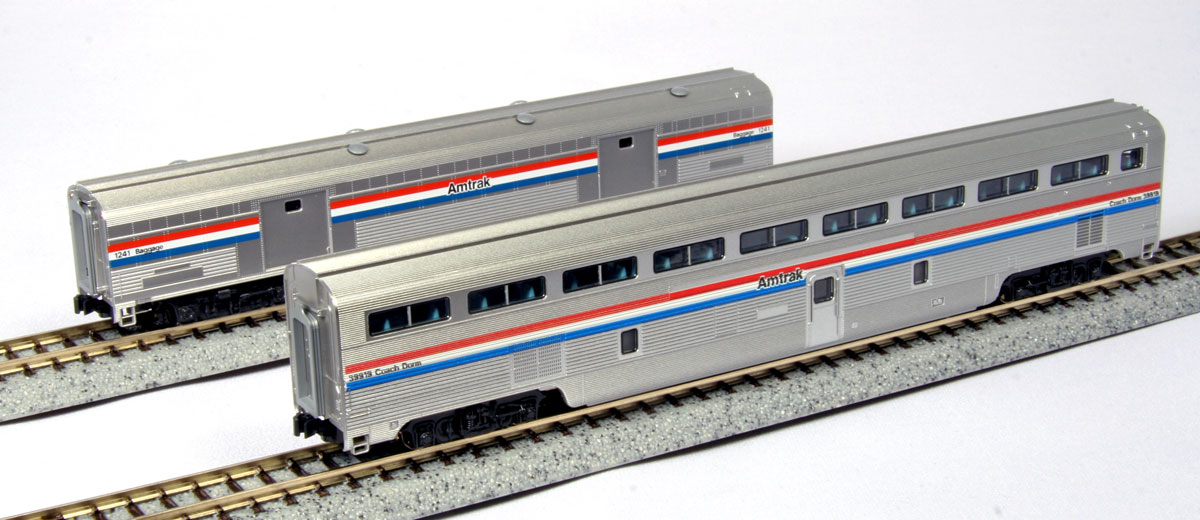 Kato 106-7122 N Amtrak Phase III Step Down Coach & Baggage Car/2pk This is Kato 106-7122 N Amtrak PhIII Step Down Coach & Baggage Car/2pk. The Budd-built Hi-Level cars had a great influence on Amtrak's passenger service, revolutionizing economy coach travel with their double-decker design. Even after the advent of the Superliner car, many of these Budd cars remained in service, in particular the Step-Down coach originally used to transition between single level and hi-level cars on the El Capitan. These cars, along with de-skirted (for easier maintenance) Santa Fe Baggage cars, were a staple on all Superliner trains up to the introduction of the Superliner II car in 1990.Its key features are:Fully detailed interiors can be lit with optionalInterior lighting kit with LED #11-209/11-210Finely detailed with prototype accurate painting and letteringFree and smooth rolling trucks for maximum performanceAll cars are equipped with Kato semi-automatic knuckle couplersDesigned to be pulled by Kato's EMD F40PH or GE P42 Genesis locomotivesSet includes:Phase III Amtrak Step-down coach #39919Phase III Baggage car #1241Condition: Factory New (C-9All original; unused; factory rubs and evidence of handling, shipping and factory test run.Standards for all toy train related accessory items apply to the visual appearance of the item and do not consider the operating functionality of the equipment.Condition and Grading Standards are subjective, at best, and are intended to act as a guide. )Operational Status: FunctionalThis item is brand new from the factory.Original Box: Yes (P-9May have store stamps and price tags. Has inner liners.)Manufacturer: KatoModel Number: 106-7122MSRP: $55.00Scale/Era: N ScaleModel Type: Passenger CarsAvailability: Ships in 1 Business Day!The Trainz SKU for this item is P11663327. Track: 11663327 - No Location Assigned - 001 - TrainzAuctionGroup00UNK - TDIDUNK