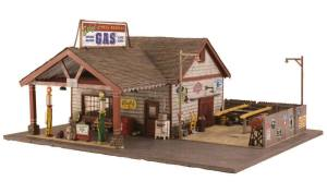 Woodland Scenics BR5849 O Scale Built-Up Ethyl's Gas & Service Station This vintage gas and service station with its open-beamed overhang, the old globed gas pumps, decals, signage and scene-setting detail is loaded with charm and nostalgia. Details include trash cans, an old bench and chair, cola machine, ice machine and pallets of old junk and car parts. The fenced outdoor service area features an oil-stained concrete floor, a lift, free-standing kerosene tank, old tires, dolly, pole lights and loads more. Includes one amber-colored exterior and two white interior lights.Condition: Factory New (C-9All original; unused; factory rubs and evidence of handling, shipping and factory test run.Standards for all toy train related accessory items apply to the visual appearance of the item and do not consider the operating functionality of the equipment.Condition and Grading Standards are subjective, at best, and are intended to act as a guide. )Operational Status: FunctionalThis item is brand new from the factory.Original Box: Yes (P-9May have store stamps and price tags. Has inner liners.)Manufacturer: Woodland ScenicsModel Number: BR5849MSRP: $159.99Scale/Era: O ModernModel Type: Accessories & BuildingsAvailability: Ships in 1 Business Day!The Trainz SKU for this item is P11970009. Track: 11970009 - No Location Assigned - 001 - TrainzAuctionGroup00UNK - TDIDUNK