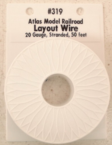 Atlas 319 50 Ft. Light Blue  20 Gauge Layout Hookup Wire This is an Atlas 319 Light Blue Wire Reel. This reel is 20 gauge, standard and contains 50 feet of wire. This size wire is great for power to HO & N layouts and for lights, turnouts, and accessories on any scale layout. Use the Atlas 6900 series 16 gauge wire for power to O and G scale layouts.Condition: Factory New (C-9All original; unused; factory rubs and evidence of handling, shipping and factory test run.Standards for all toy train related accessory items apply to the visual appearance of the item and do not consider the operating functionality of the equipment.Condition and Grading Standards are subjective, at best, and are intended to act as a guide. )Operational Status: FunctionalThis item is brand new from the factory.Original Box: Yes (P-9May have store stamps and price tags. Has inner liners.)Manufacturer: AtlasModel Number: 319MSRP: $10.95Scale/Era: O ModernModel Type: Electronics & WiringAvailability: Ships within 3 Business Days!The Trainz SKU for this item is P11381615. Track: 11381615 - 4029-D (Suite 2730-100)  - 001 - TrainzAuctionGroup00UNK - TDIDUNK