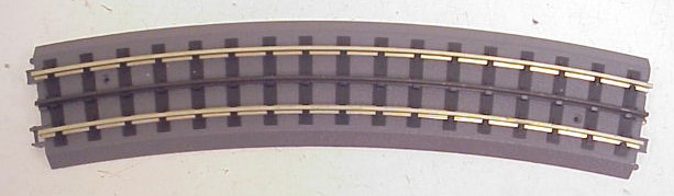 MTH 40-1010 RealTrax O72 Curve Track MTH 40-1010 RealTrax O72 Curve Track Section. 16 sections are required to make a complete 72 inch diameter circle. Realtrax is simply the easiest O Gauge track system ever manufactured. Featuring hollow metal rails strong enough to stand on and a built-in roadbed for a realistic appearance ensures that a RealTrax layout will last for years while sporting a realistic appearance not found in other O Gauge track systems. RealTrax incorporates built-in track bed joiners and long-lasting sprung- metal electrical connectors that make assembling RealTrax literally a snap. Because the roadbed is solid, RealTrax is perfect for temporary carpet based layouts. The built-in roadbed prevents any dirt from staining your carpet and it comes apart so easily that your temporary layout can be disassembled in minutes. While the RealTrax system employs solid nickel-silver rails that won't rust or oxidize in an outdoor environment, the plastic roadbed and rail ties are constructed of ABS plastic that can be compromised outdoors. Essentially, ABS plastic is not designed to withstand extreme temperature swings and can distort (in high heat) or crack in extreme cold. In addition, the plastic will tend to fade in color since it has not been treated with UV resistant paint. As a result, we do not recommend that RealTrax be used outdoors.Condition: Factory New (C-9All original; unused; factory rubs and evidence of handling, shipping and factory test run.Standards for all toy train related accessory items apply to the visual appearance of the item and do not consider the operating functionality of the equipment.Condition and Grading Standards are subjective, at best, and are intended to act as a guide. )Operational Status: FunctionalThis item is brand new from the factory.Original Box: Yes (P-9May have store stamps and price tags. Has inner liners.)Manufacturer: MTHModel Number: 40-1010Years Manufactured: 1998 - 2000MSRP: $6.99Scale/Era: O ModernModel Type: