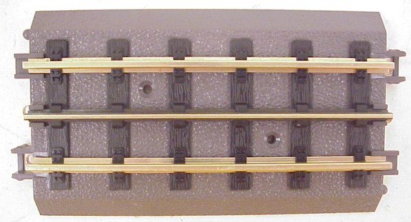 MTH 40-1016 RealTrax 5 Inch Straight Track This is a section of MTH 40-1016 RealTrax 5 Inch Straight Track. Realtrax is simply the easiest O Gauge track system ever manufactured. Featuring Hollow metal rails strong enough to stand on and a built-in roadbed for a realistic appearance ensures that a RealTrax layout will last for years while sporting a realistic appearance not found in other O Gauge track systems. RealTrax incorporates built-in track bed joiners and long-lasting sprung- metal electrical connectors that make assembling RealTrax literally a snap. Because the roadbed is solid, RealTrax is perfect for temporary carpet based layouts. The built-in roadbed prevents any dirt from staining your carpet and it comes apart so easily that your temporary layout can be disassembled in minutes. While the RealTrax system employs solid nickel-silver rails that won't rust or oxidize in an outdoor environment, the plastic roadbed and rail ties are constructed of ABS plastic that can be compromised outdoors. Essentially, ABS plastic is not designed to withstand extreme temperature swings and can distort (in high heat) or crack in extreme cold. In addition, the plastic will tend to fade in color since it has not been treated with UV resistant paint. As a result, we do not recommend that RealTrax be used outdoors.Condition: Factory New (C-9All original; unused; factory rubs and evidence of handling, shipping and factory test run.Standards for all toy train related accessory items apply to the visual appearance of the item and do not consider the operating functionality of the equipment.Condition and Grading Standards are subjective, at best, and are intended to act as a guide. )Operational Status: FunctionalThis item is brand new from the factory.Original Box: Yes (P-9May have store stamps and price tags. Has inner liners.)Manufacturer: MTHModel Number: 40-1016Years Manufactured: 1998 - ????MSRP: $4.49Scale/Era: O ModernModel Type: Track/Switches/Etc.Availability: Ships with