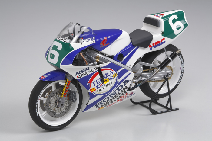 Tamiya 14110 1/12 1990 Ajinomoto Honda NSR250 GP Racing Motorcycle This is Tamiya 14110 1/12 1990 Ajinomoto Honda NSR250 GP Racing Motorcycle. From 1988, Masahiro Shimizu was competing in the MotoGP 250cc class, and was considered by many as a rider with a rare talent. He first gained worldwide attention by taking pole position at Suzuka in 1987, and after winning the All-Japan Championship that year went on to the bigger MotoGP stage under the sponsorship of Ajinomoto. At the highest level, he earned Top-10 overall ranking finishes in 3 consecutive years before retiring in 1992.Its key features are:Cowlings are made from clear plastic material, so modelers can choose to leave them unpainted to enable viewing of interior detailsSmall precision-made screws are used to attach/detach the cowlings, engine, and wheelsRear suspension features metal coil spring for enhanced realismSolid synthetic rubber tires provide an authentic racing flavorBeautiful Cartograf decals, including special markings for the perforated side cowlings, depict bike ridden by Masahiro Shimizu to 2nd place at the 1990 British GPPaints needed: Silver Leaf, Black, Chrome Silver, Gold Leaf, Semi Gloss Black, White, Clear Red, Titanium Gold, Titanium Silver, Bronze, Flat Black, Flat Aluminum, Medium Grey, Dark Copper, Metallic GreyCondition: Factory NewOperational Status: FunctionalThis item is brand new from the factory.Original Box: YesManufacturer: TamiyaModel Number: 14110MSRP: $44.00Category 1: Other ToysCategory 2: Model KitsAvailability: Ships in 3 to 5 Business Days.The Trainz SKU for this item is P12000172. Track: 12000172 - FS - 001 - TrainzAuctionGroup00UNK - TDIDUNK