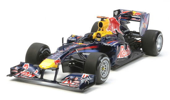 Tamiya 20067 1/20 Renault RB6 Red Bull Race Car This is Tamiya 20067 1/20 Renault RB6 Red Bull Race Car. The RB6 car that brought S. Vettel his maiden Formula One Drivers' Championship and Red Bull Racing its first Constructors' Championship joins the Tamiya 1/20 scale model line-up. This aerodynamic trend-setter was the brainchild of Red Bull Racing's Chief Technical Officer Adrian Newey and the mechanics team of Red Bull Racing. The sharp-edged V-nose, blown diffuser and pull rod rear suspension system, all trend-setters at the time, can now be reproduced and appreciated in detail while assembling this exquisite model.Its key features are:1/20 scale plastic model assembly kit of the 2010 Formula One world championship-winning Red Bull Racing Renault RB6Length: 248mm, Width: 92mmThe car's unique form is faithfully captured, including the compact and flowing side pontoons, the raised edges of the V-Nose, and the shark-fin engine coverHighly-detailed F-Duct system comes as separate parts2 types of steering wheel are includedPhoto-etched parts to depict nose-side fins and side pod GPS antenna as well as seatbelt stickers includedAlso includes 2 types of onboard camera and front wing flapsHigh-quality Cartograf decals included to depict the No.5 and No.6 carsPaints needed: Pearl Blue, Chrome Yellow, Gloss Aluminum, White, Red, Lemon Yellow, Chrome Silver, Sky Blue, Light Green, Pink, Semi-Gloss Black, Titanium Gold, Titanium Silver, Metallic Brown, Flat Black, Flat White, Flat Blue, Flat Aluminum, BuffCondition: Factory NewOperational Status: FunctionalThis item is brand new from the factory.Original Box: YesManufacturer: TamiyaModel Number: 20067MSRP: $105.00Category 1: Other ToysCategory 2: Model KitsAvailability: Ships in 1 Business Day!The Trainz SKU for this item is P12000208. Track: 12000208 - No Location Assigned - 001 - TrainzAuctionGroup00UNK - TDIDUNK
