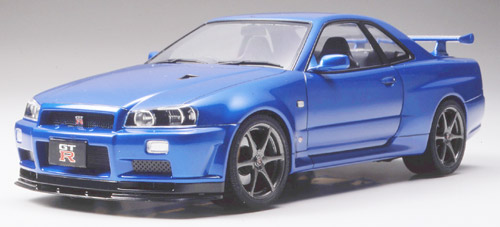 Tamiya 24258 1:24 Nissan Skyline GT-R R34 This is Tamiya 24258 1:24 Nissan Skyline GT-R R34. The Nissan Skyline GT-R (R32), released in 1989, was developed as a base machine for Group-A races. Taking full advantage of its powerful 2.6l, 6-cylinder, twin turbo engine, it was equipped with a 4WD system. Originally designated as R32, the car was termed R33 in 1995 and R34 in 1999. In October 2000, the Skyline underwent minor changes such as the addition of large rear brakes to upgrade performance further. This new evolution was called the V-spec II. The most drastic alteration was the replacement of the aluminum hood with a new carbon hood featuring a NACA duct. The carbon pattern of the hood would stand out even when painted the same color as the car body. Both inside and outside surfaces of the hood were designed using RTM, a new construction method yeilding smooth surfaces. The V-spec II also features the previous improvements of the V-spec: front/rear diffusers and 18-inch tires, brake discs with Brembo calipers, and a 6-speed transmission. In February 2002, Nissan released a limited edition car called Nur, named after the Nurburgring circuit, and equipped with an N1 racing specification engine. Combining the impressive specifications of both the V-spec II and the M-spec, 1000 units of the Nur were produced in all. Marketed as the last GT-R to equip a straight 6 engine, all 1000 were sold-out in one day, attesting to its incredible popularity. The new 2000 gas regulation forced Nissan to end production of the GT-r in August 2002, however the glory of this ultimate sports car lives on.The metallic chrome special Nissan Skyline comes with all the plastic parts molded in a chrome blue metallic color.Its key features are:Plastic parts are attached to sprue treesBody is molded in white plasticClear pieces are included for windows, windscreen and light lensesDetailed molding of body panelsExtremely realistic suspensionRealistically detailed