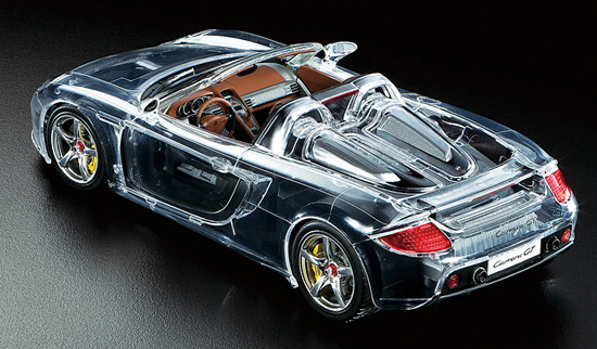 Tamiya 24330 1/24 Porsche Carrera GT Car (Full View) This is Tamiya 24330 1/24 Porsche Carrera GT Car (Full View). The Porsche Carrera GT grabbed the world's attention when first unveiled as a concept car at the 2000 Paris Auto Show. Promoted as Porsche's next generation flagship super sports car, the Carrera GT was officially unleashed onto the international motoring market in 2003. Featuring a powerful 5.7 liter V10 engine, carbon-fiber monocoque chassis and push-rod suspension all wrapped up in classic Porsche style and elegance, the Carrera GT was a true high-end sports car. Its production ran to 1,270 models by the time it ended in 2006. Now, this 1/24 scale plastic model of the Carrera GT is released, including special clear body parts to let you get more closely acquainted with the internal workings of the car.Its key features are:1/24 scale plastic modelLength: 193mm, Width: 83mm, Height: 49mmClear parts beautifully replicate the form of the curved body, including doors and engine hoodThe roof panel is recreated using separate parts, and users can choose whether to assemble an open- or closed-top modelRear hood can be opened and closed allowing display of engine and mechanics even after completionThe racing car-style monocoque and front/rear pushrod suspension are recreated in excellent detailDashboard and internal door panel parts are separated by the color they will be painted, making it easier to achieve a realistic finishModel can be assembled with rear wing in raised or lowered positionDisplay quality is further enhanced by the metal transfers used for mirrors and the Porsche emblemPaints needed: Italian Red, Black, Gloss Aluminum, Semi-Gloss Black, Metallic Black, Light Gunmetal, Chrome Yellow, White, Red, Lemon Yellow, Chrome Silver, Clear Blue, Clear Red, Titanium Silver, Flat Black, Flat Yellow, Flat Red, Flat Aluminum, Metallic Gray, Dark Yellow, Red BrownCondition: Factory NewO