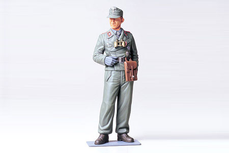 Tamiya 36301 1/16 Wehrmacht Tank Crewman This is a Tamiya 36301 1/16 Wehrmacht Tank Crewman. This is a plastic model kit of the 1/16 Scale Plastic WWII German Wehrmacht Tank Crewman Figure Kit from Tamiya. It's recommended for ages 10 and up.Product Features:Plastic pieces molded in grey and attached to sprues.Ready to assemble precision model kit.Highly detailed clothing and facial expression.Modeler can choose to assemble the figure in one of two natural poses.Includes interesting information about uniform badges.Figure includes an officers field cap, an M43 field cap, a map case, binoculars, a Walther holster, a cross badge, a tank badge, and anassault badge.Assembly and painting instructions are printed on box.Condition: Factory NewOperational Status: FunctionalThis item is brand new from the factory.Original Box: YesManufacturer: TamiyaModel Number: 36301MSRP: $13.50Category 1: Other ToysCategory 2: Model KitsAvailability: Ships in 3 to 5 Business Days.The Trainz SKU for this item is P12000550. Track: 12000550 - FS - 001 - TrainzAuctionGroup00UNK - TDIDUNK