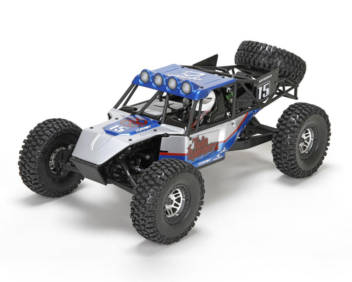 Vaterra 03013 Twin Hammers 1.9 Rock Racer 1/10th RTR V2 This is a Vaterra 03013 Twin Hammers 1.9 Rock Racer 1/10th RTR V2. No longer do you have to choose between a 1.9 crawler and an off-road buggy. With the Twin Hammers™ rock racer, you get the best of both worlds in one bone-crushing vehicle. Easily handle anything you come up against, from jagged rocks to extreme jumps. Just shift the two-speed transmission on the fly and you're good to go. Your next adventure is waiting. And it starts with the Twin Hammers. the fly and you're good to go.Condition: Factory NewOperational Status: FunctionalThis item is brand new from the factory.Original Box: YesManufacturer: VaterraModel Number: 03013MSRP: $399.99Category 1: Other ToysCategory 2: Radio Control ToysAvailability: Ships in 1 Business Day!The Trainz SKU for this item is P12126464. Track: 12126464 - No Location Assigned - 001 - TrainzAuctionGroup00UNK - TDIDUNK